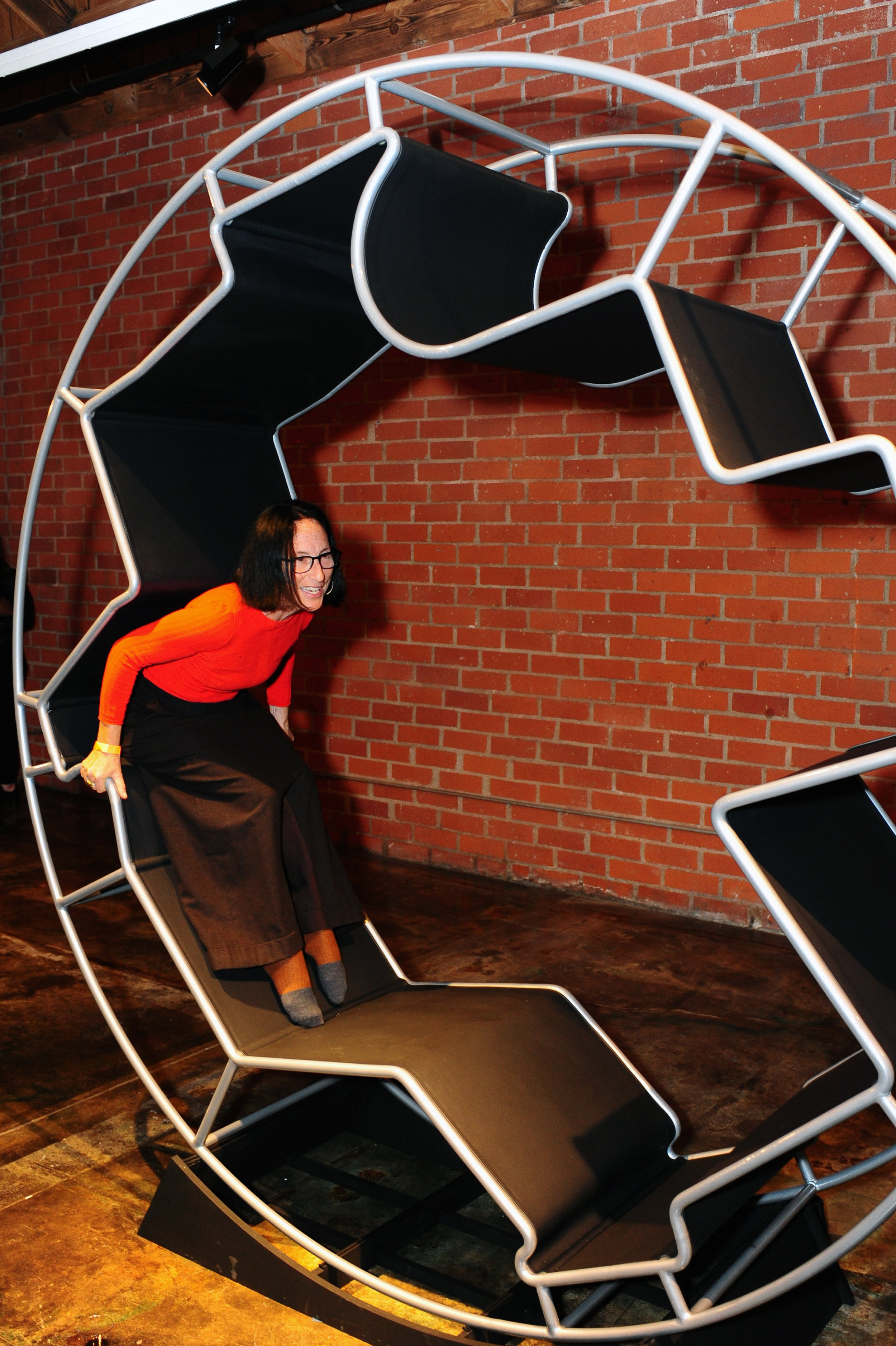 Sylvia Lavin tests out the Zero Gravity Wheel designed by Marta Nowak of AN.ONYMOUS.