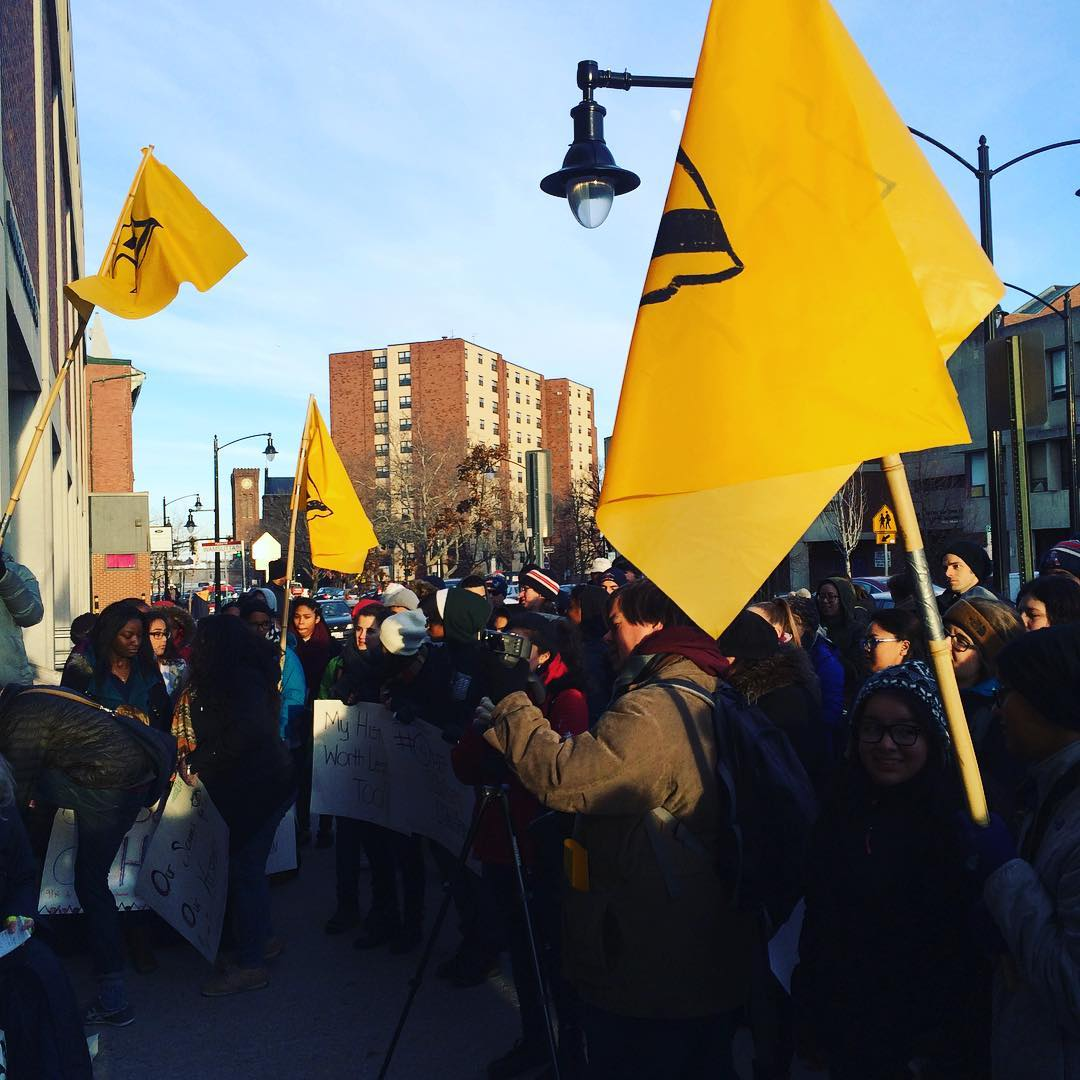 crowd-holding-providence-student-union-flags-rally-outside-school-department.jpg