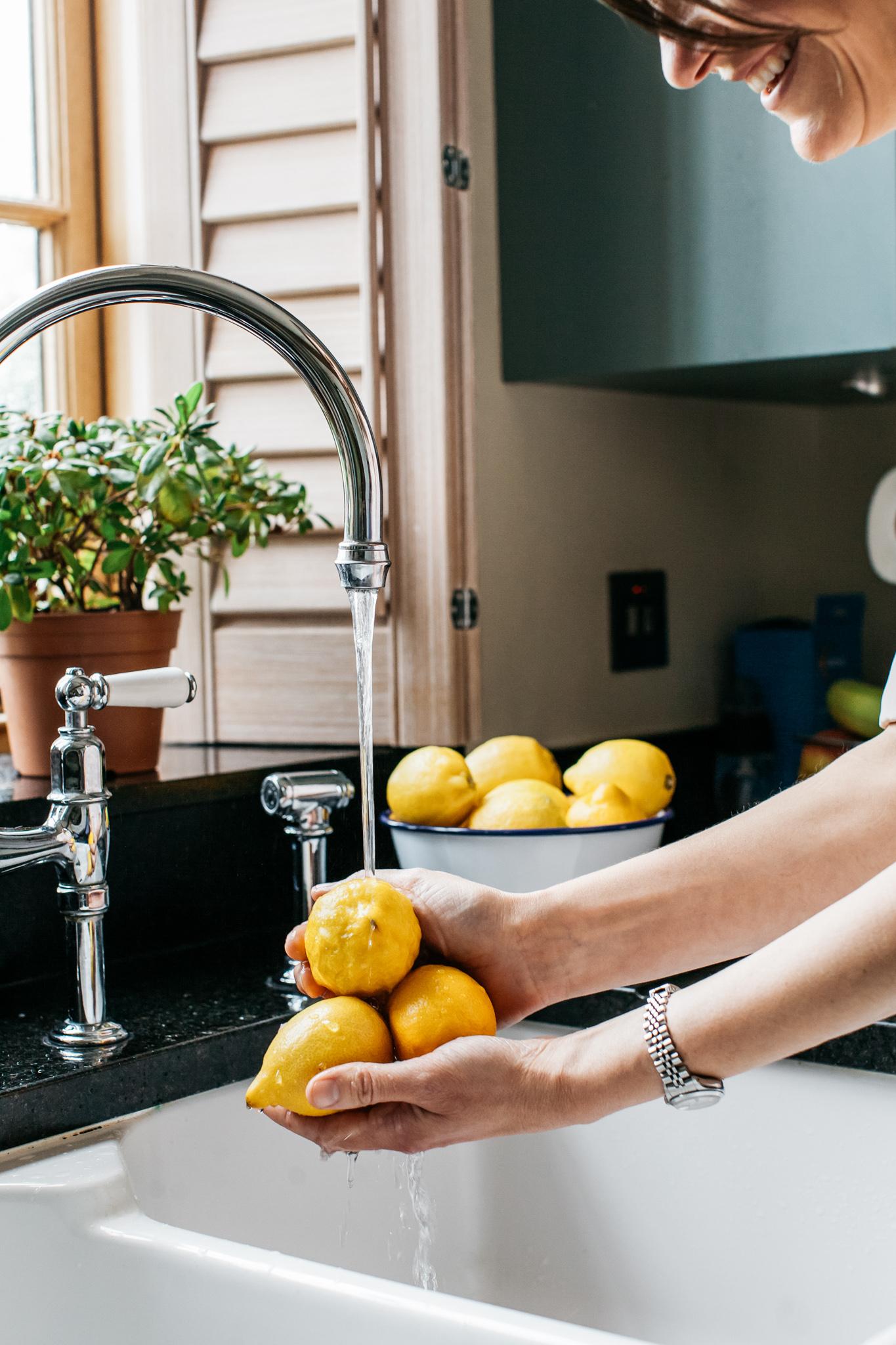 Washing lemons Food lifestyle photography for Bare Biology by Emma Gutteridge