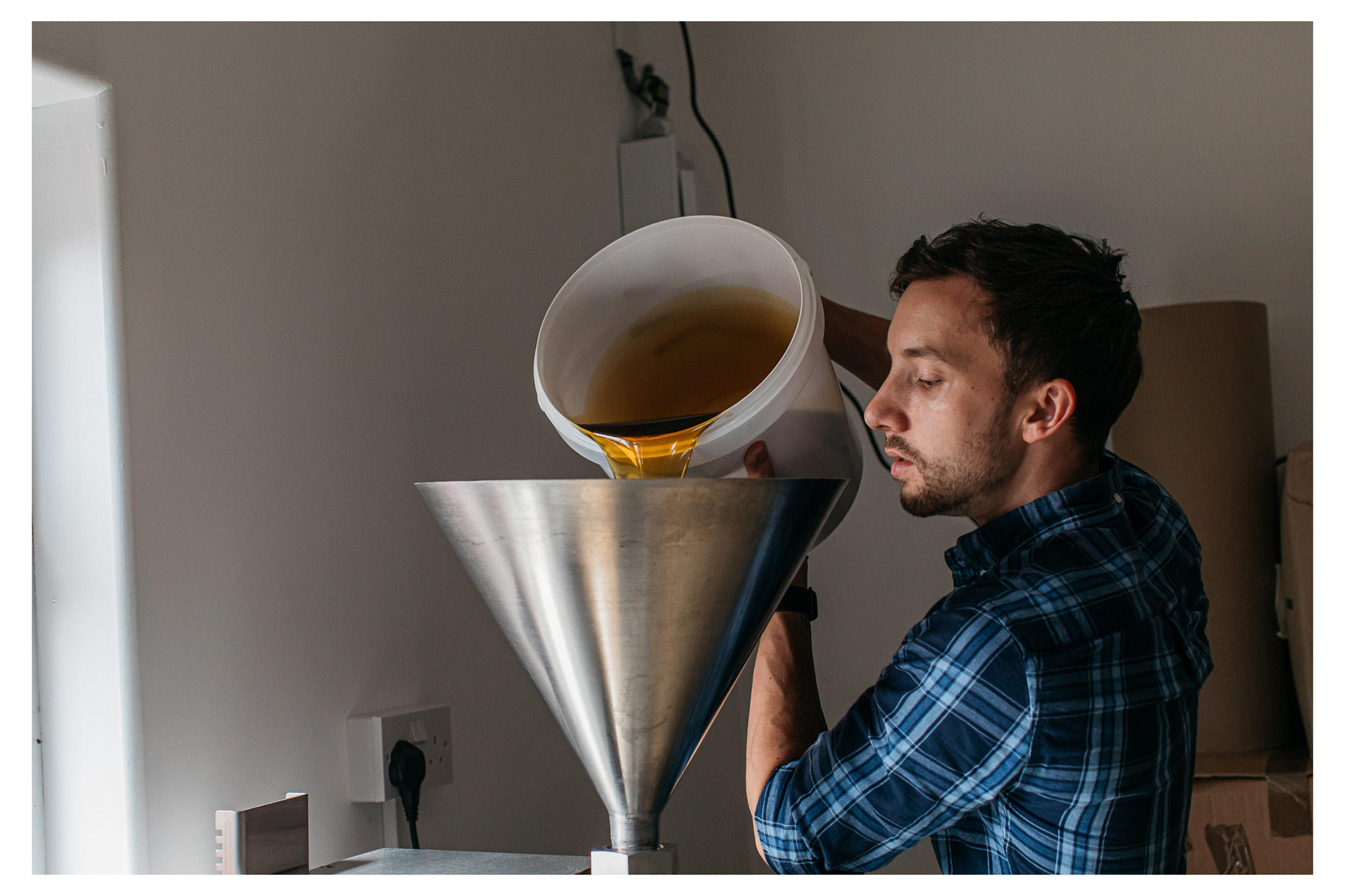 Natural honey extraction method photographed for Aecre honey by Emma Croman