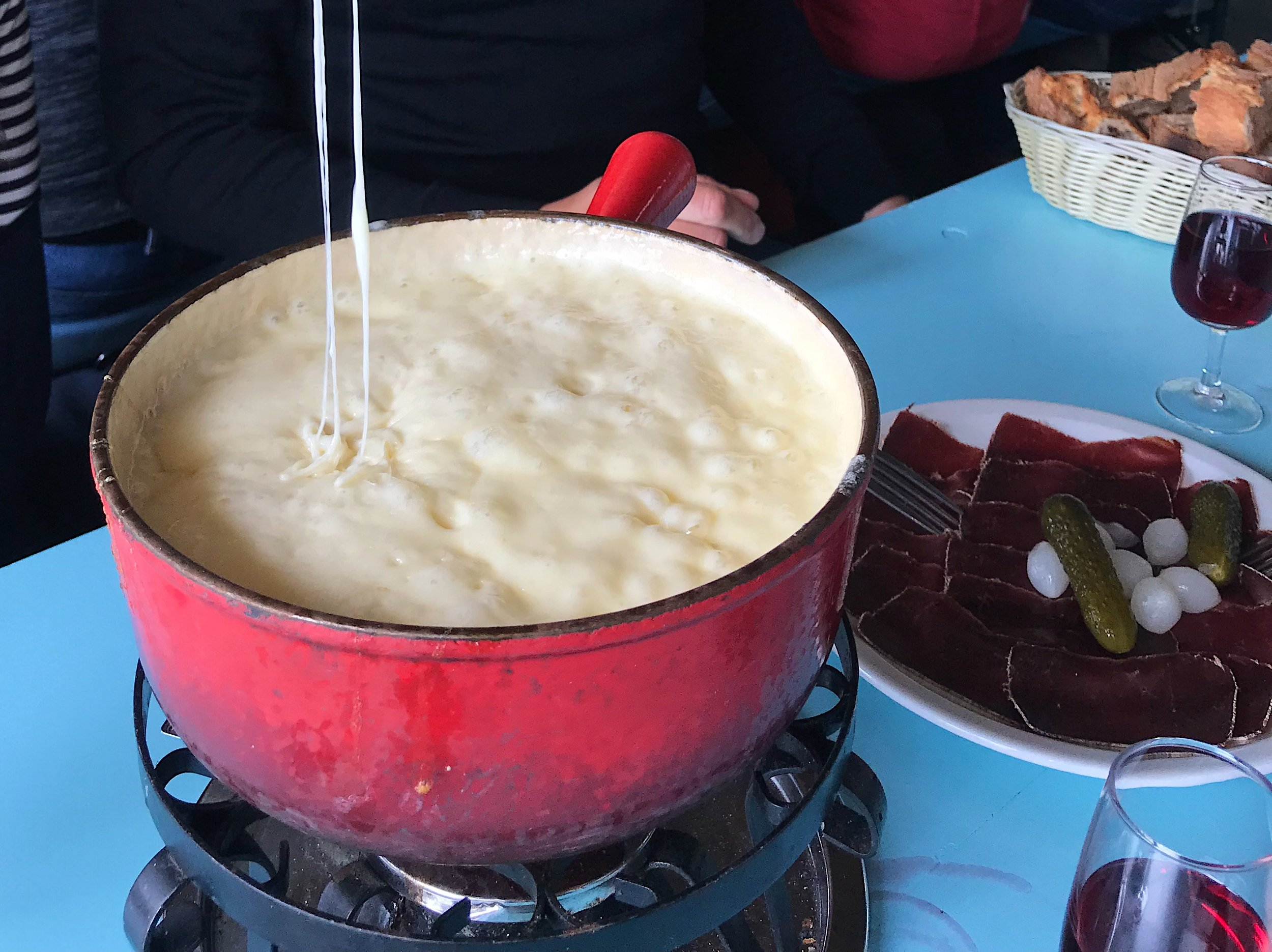 The fondue au crémant (fondue with sparkling wine) in all of its cheesy, bubbling glory