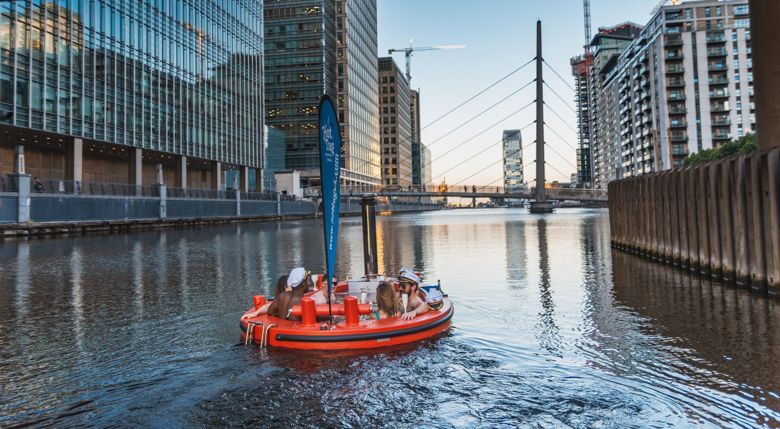 WEST INDIA QUAY/CANARY WHARF - Sailing between some of Europe's tallest buildings is quite the spectacle. An ideal base for groups. We also allow music at this location.