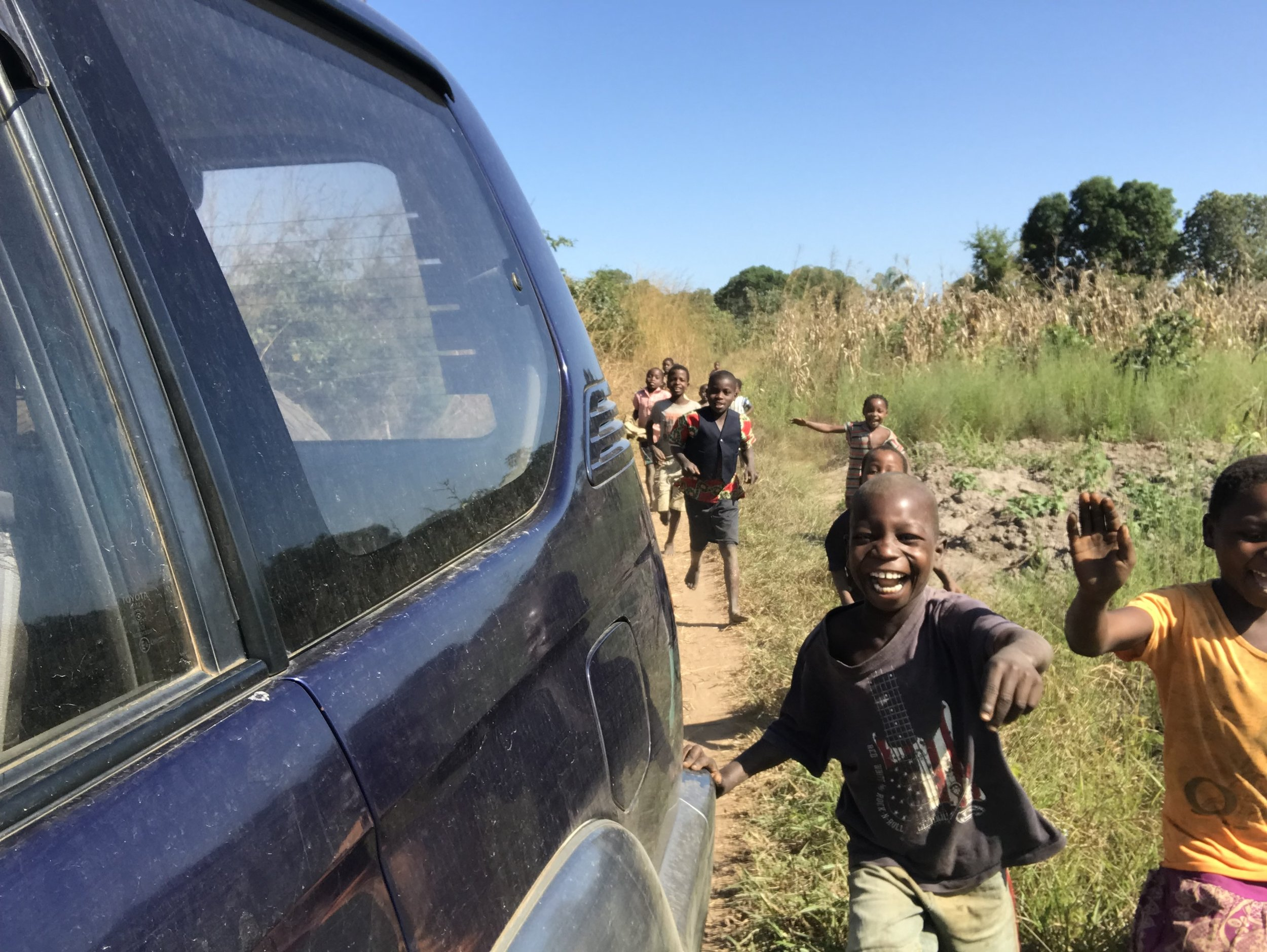 Kids running after our car when we enter the village. One of the sweetest sights for me.