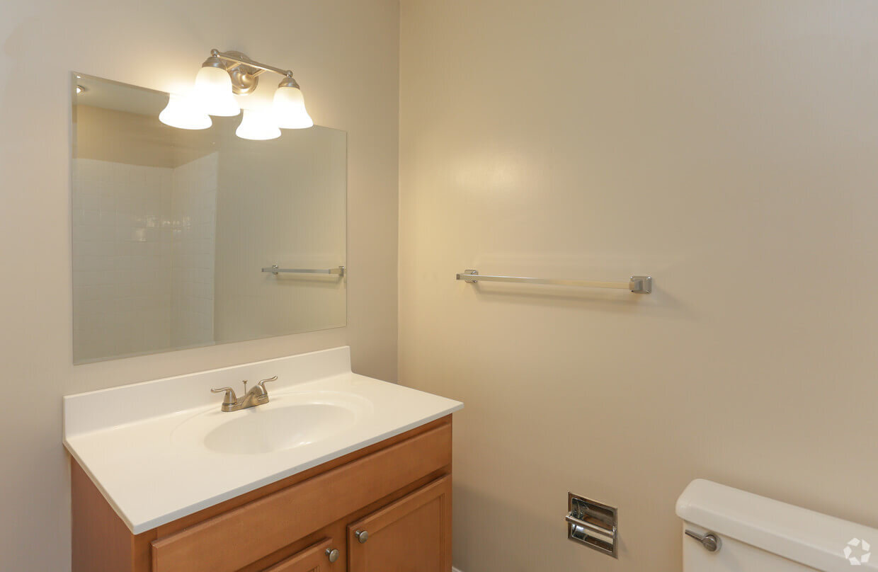 Apartment Bathroom Vanity with mirror and lights above