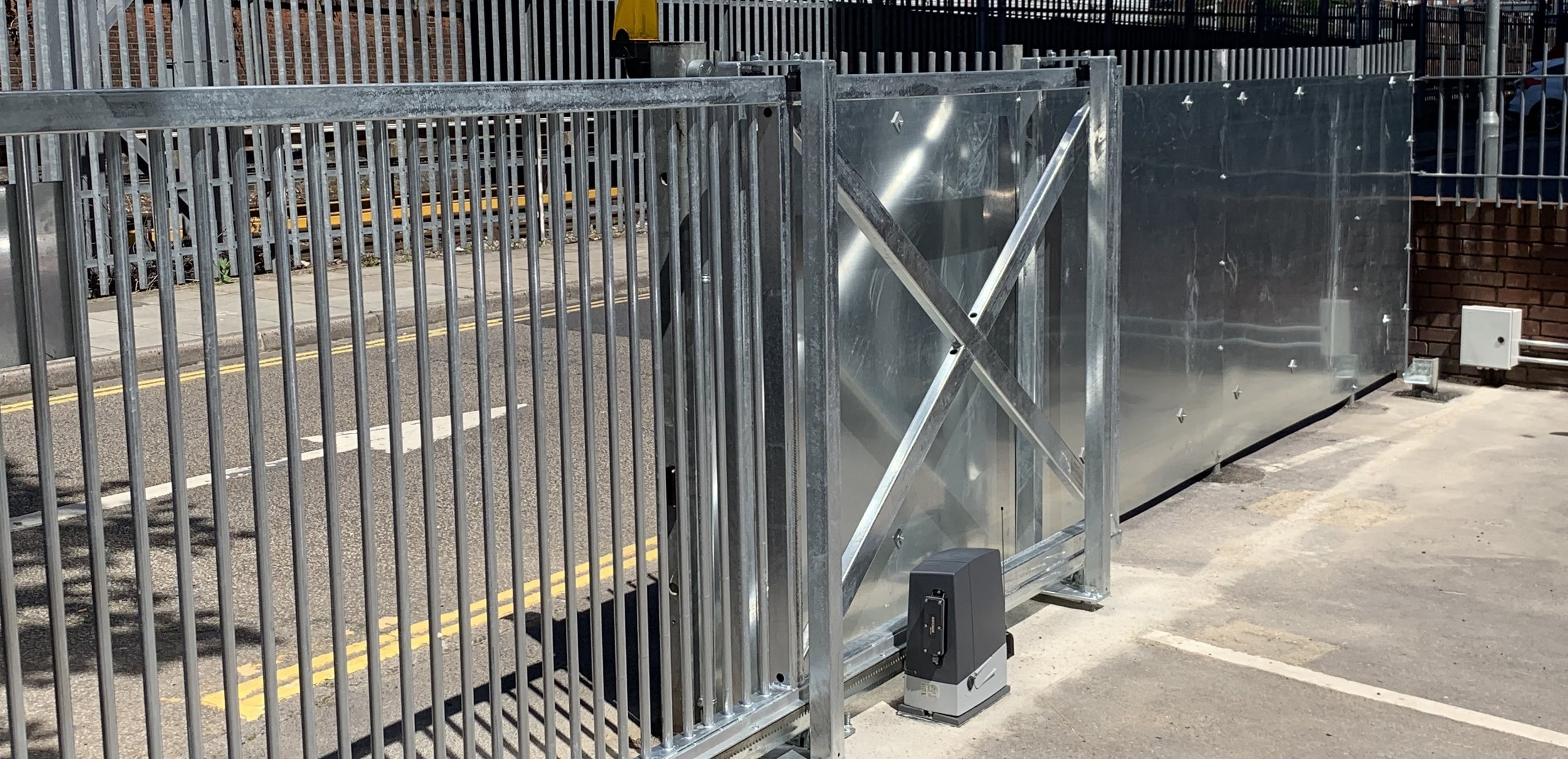 The unite group- - Installed new automated galvanised box section slide gate, including metal work, ironmongery and motors. New underground ducting and power supply with an additional access control and full security lighting system.