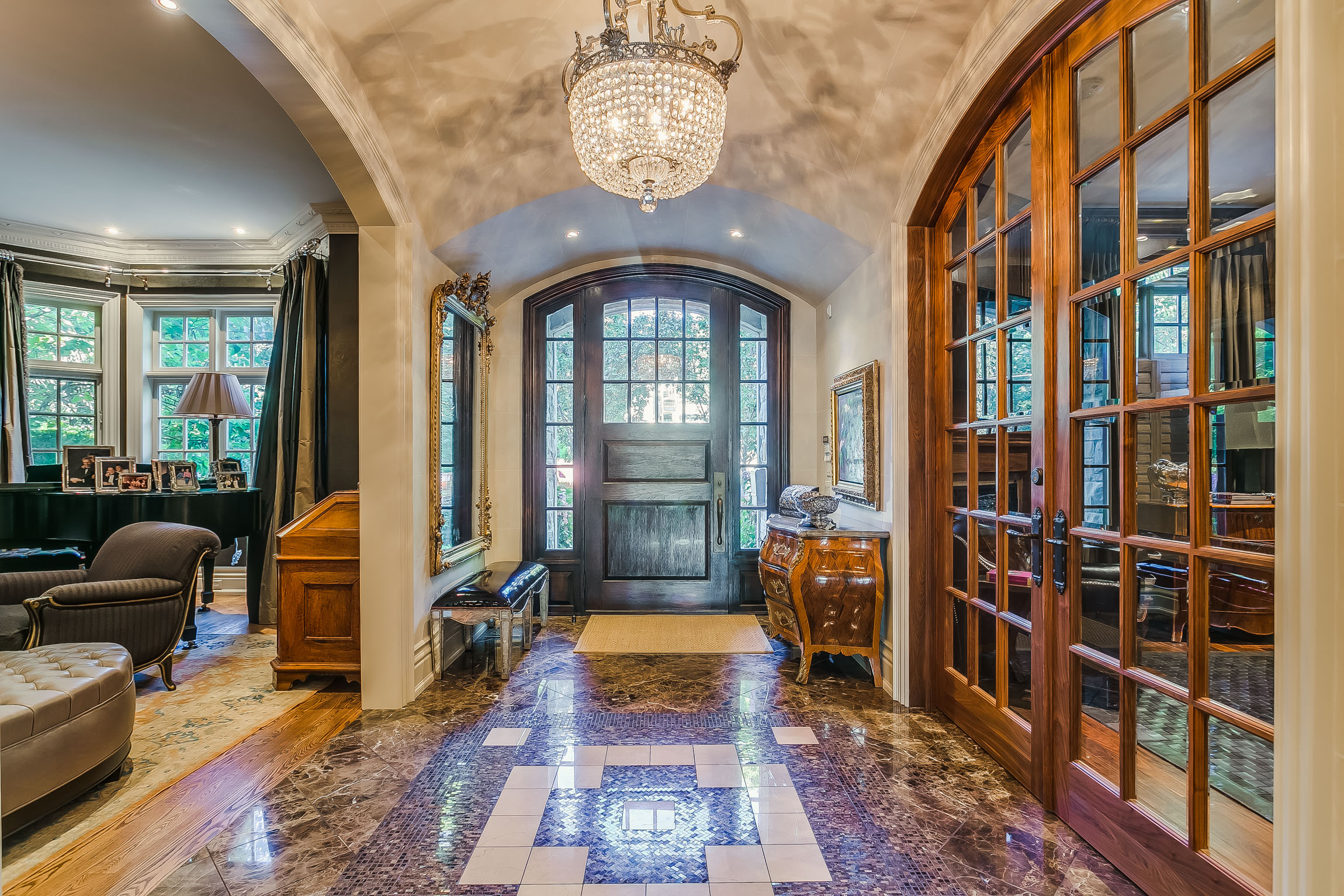 The Foyer - From The Pristine Front Walkway, There Is An Immediate Sense of Grandeur and Warmth, Upon Entering Into The Marble Lined Foyer. To Describe The Detail and Beauty of This Home Is Unjustified Until One Has The Opportunity To Experience For Themselves.