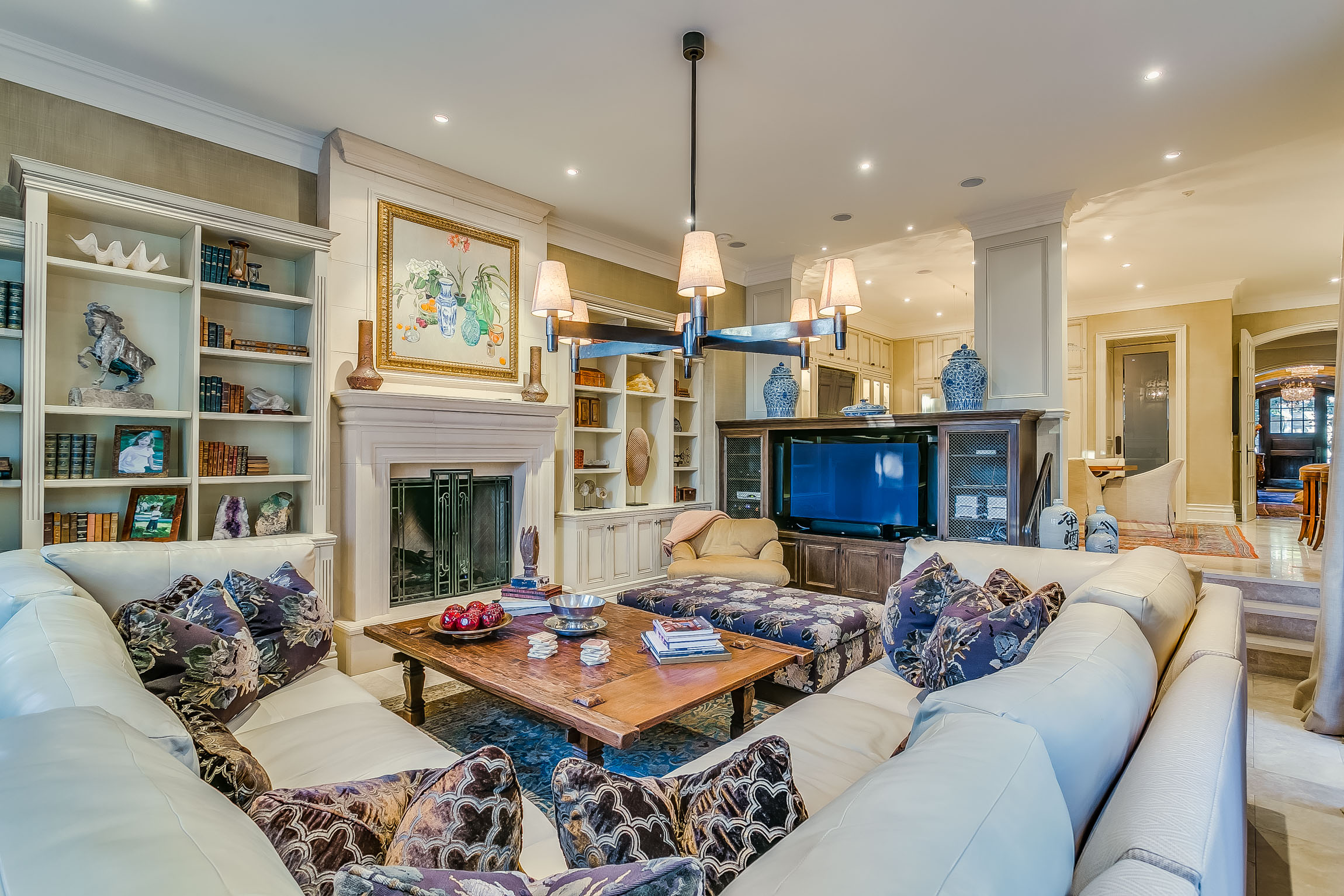 family room - Beyond The Kitchen, A Sunken Family Room Is Just As Inviting. Surrounded By Custom Built In Cabinetry, Cozy Gas Fireplace and Two Double French Door Walk Outs, Some Guests May Never Leave!