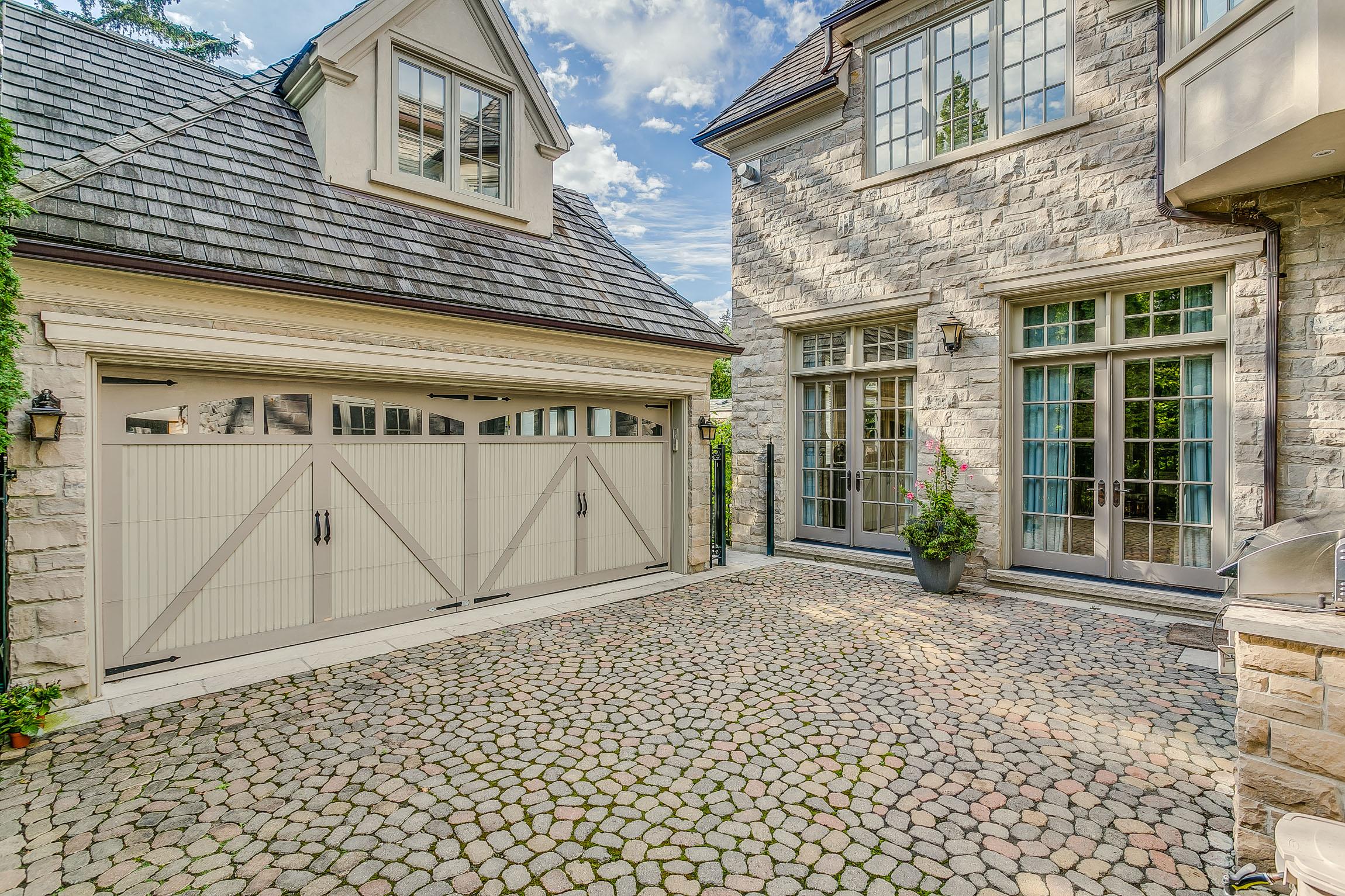 the garage - Nothing Has Been Overlooked In This Home Consisting Of Over 8000SF of Living Space, Including A Tunnel Connecting The Lower Level To The Coach House, Atop The Custom Designed Garage.