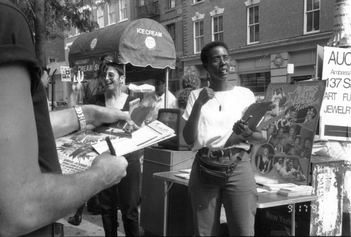 Molly Honingsfeld (left) and Jamela Stevens (right) in a Castillo fundraising street performance on the streets of New York City, 1992. (Photo by David Nackman)