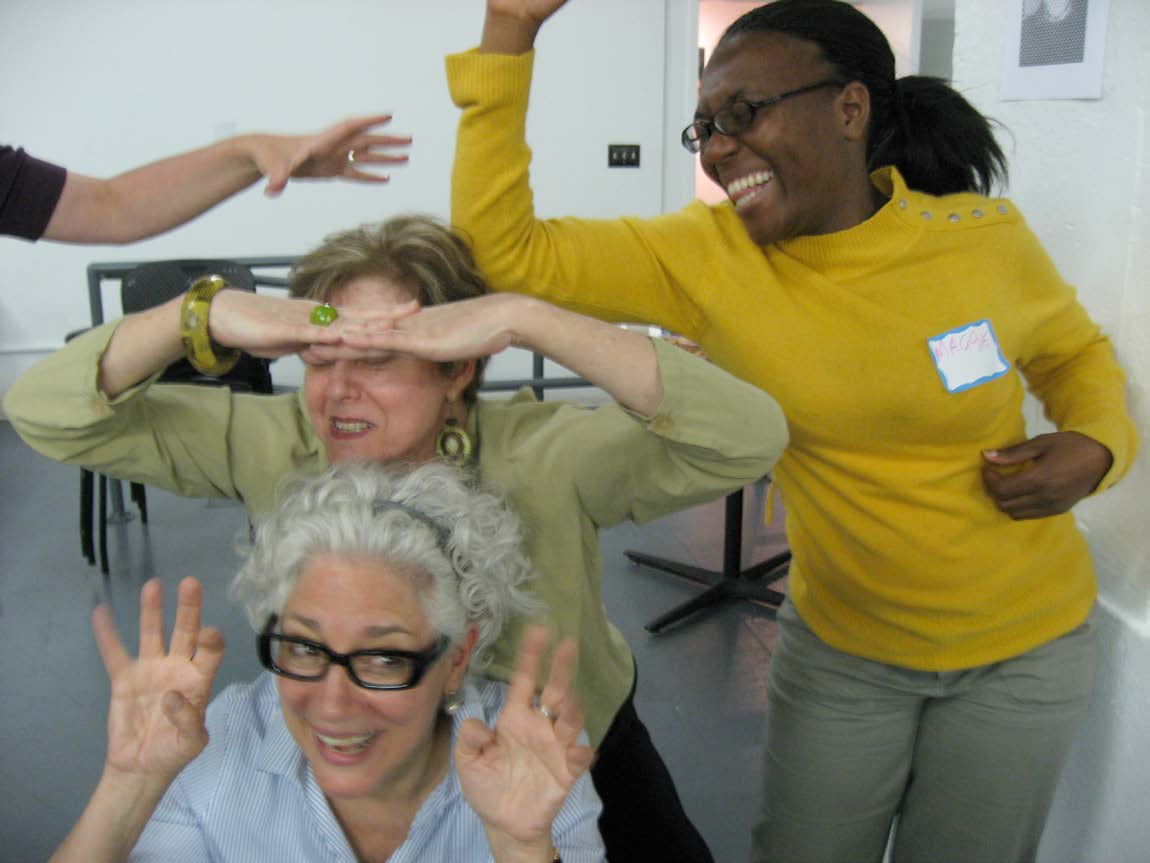 """Castillo actress Vicky Wallace (center) with Castillo volunteers at a """"Camp Hamletmachine"""" workshop; one of a series of workshops at which Castillo volunteers and audience members played with the text of Hamletmachine by Heiner Müller, in preparation for its production at the Castillo Theatre, directed by Eva Brenner, June 2009. (Photo by Diane Stiles)"""