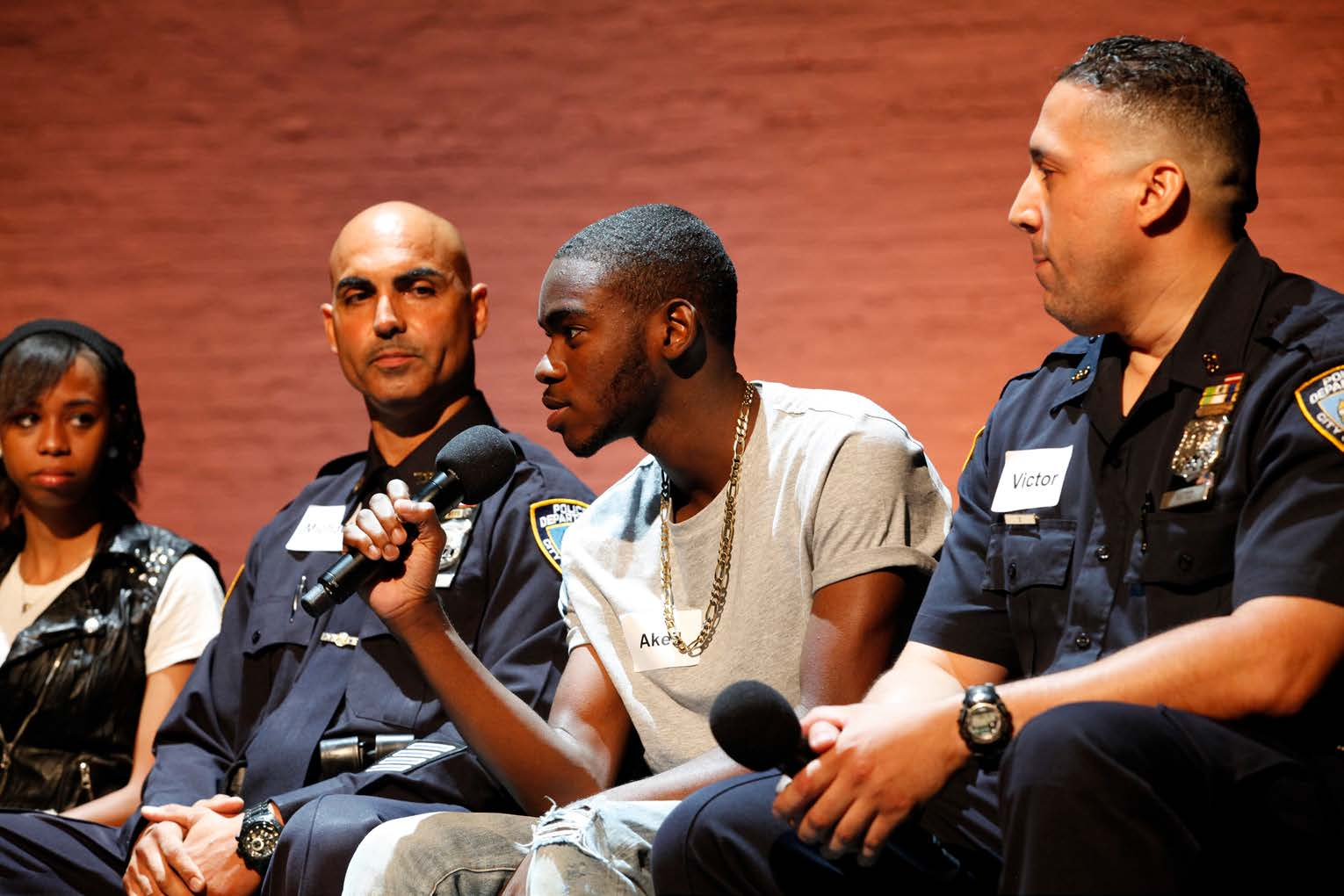 Operation Conversation: Cops & Kids demonstration workshop at the Apollo Theater, August 2014. (From left) Starshima Trent, Officer Michael Murdock, Akeil Davis, and Officer Victor Ramos. (Photo by Kenneth Pietrobono)