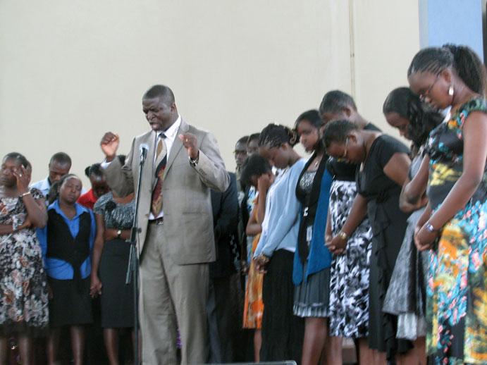 Bishop praying over team at Kabarak