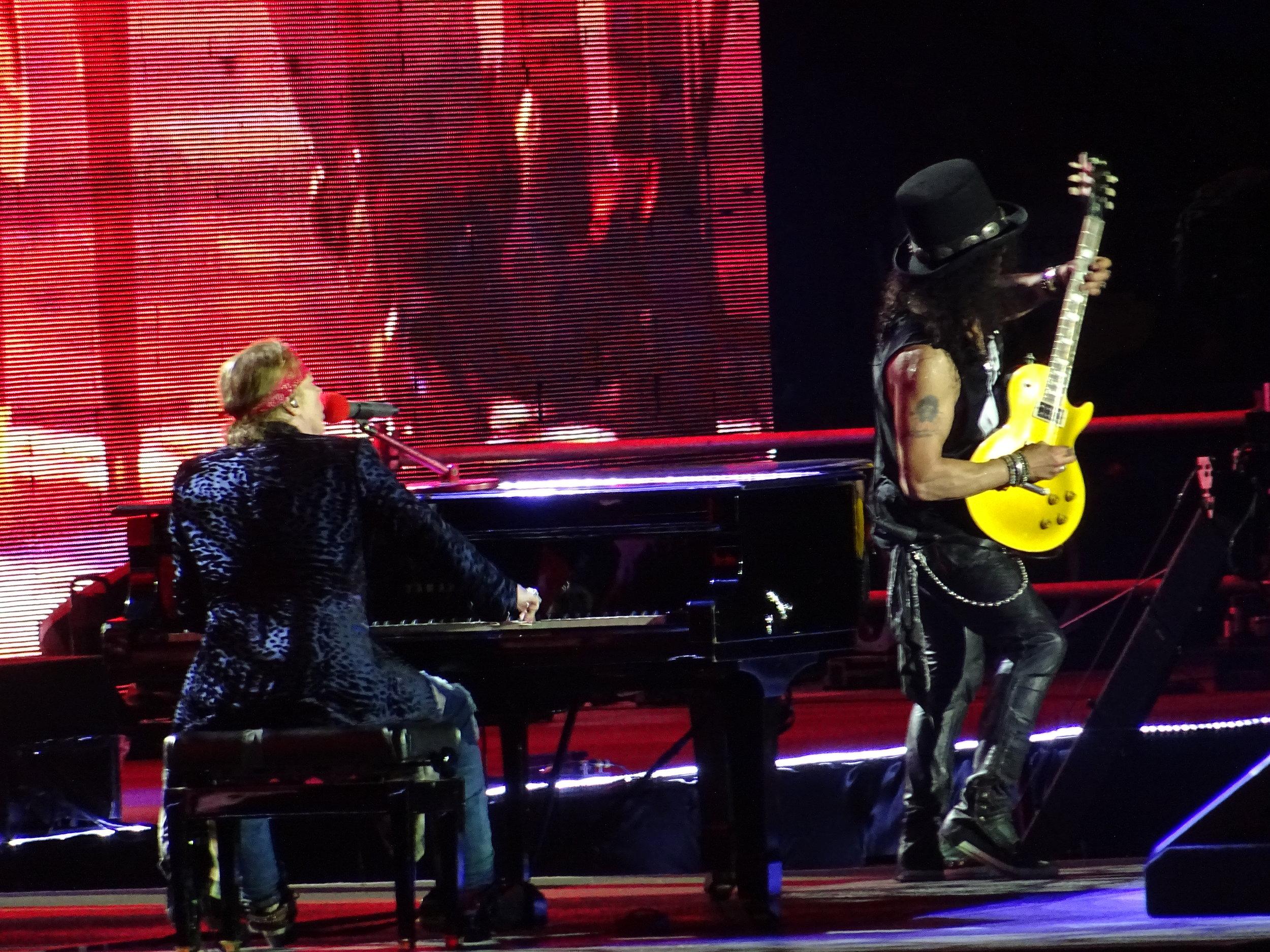 Axl sits down at the piano as Slash shreds the November Rain solo Picture (c) Philip Giouras @ The Perfect Tempo