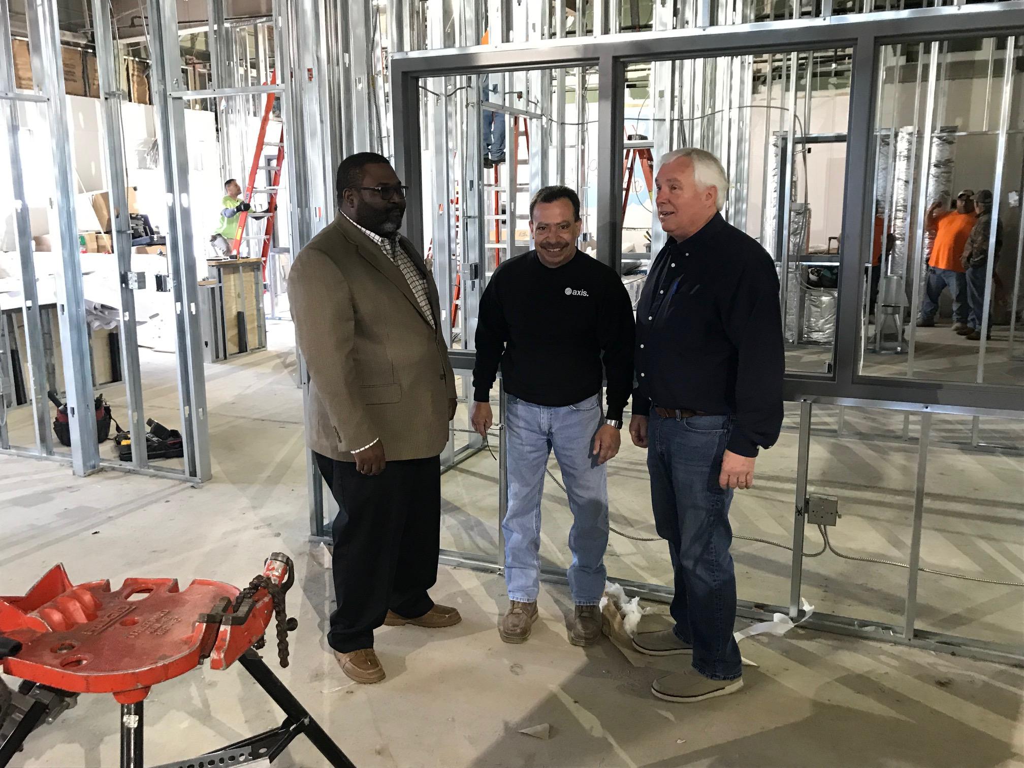 Joseph's House Executive Director James Wynn, Axis Job Superintendent Dan Barges and Board Member John Klein inspect progress.