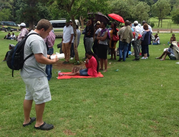 Ricky preaches in a park in South Africa.