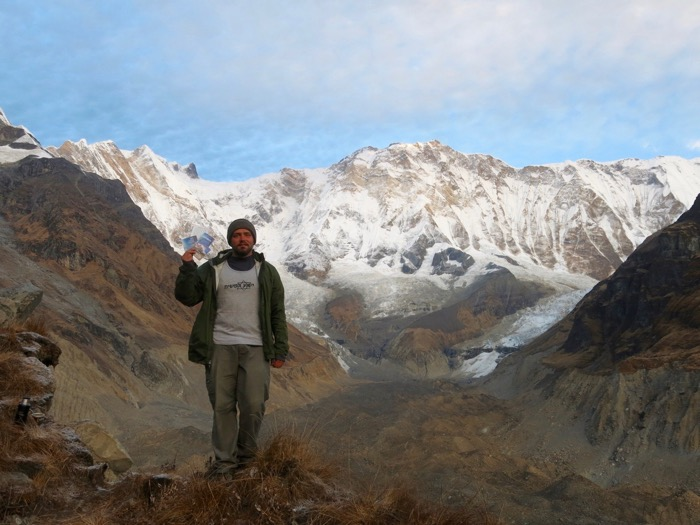 Ricky stands below the south face of Annapurna I, one of the highest mountains in the world.