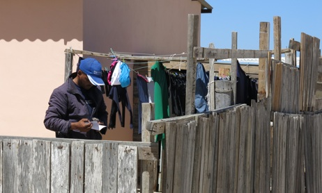 A man reads a Gospel tract in the Port Nolloth township.