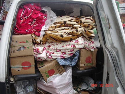Loading Up Blankets, Other Supplies, and Gospel Materials for Affected Village Areas