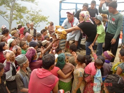 Distributing Rice, Beans, and Blankets from the Back of a Truck