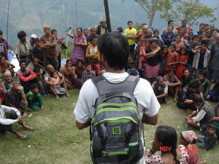 People gather to hear the Gospel preached in the open air.