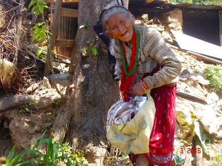 This elderly woman receives a blanket and a few other supplies.