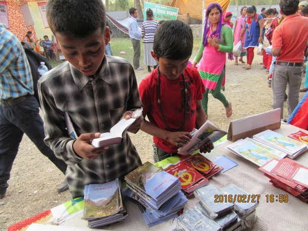 Tons of Gospel tracts go out at a trade show near Buddha's birthplace.