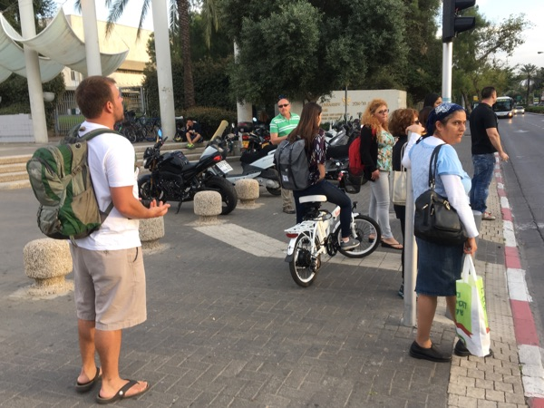 Ricky preaches at Tel Aviv University as students get out of class.