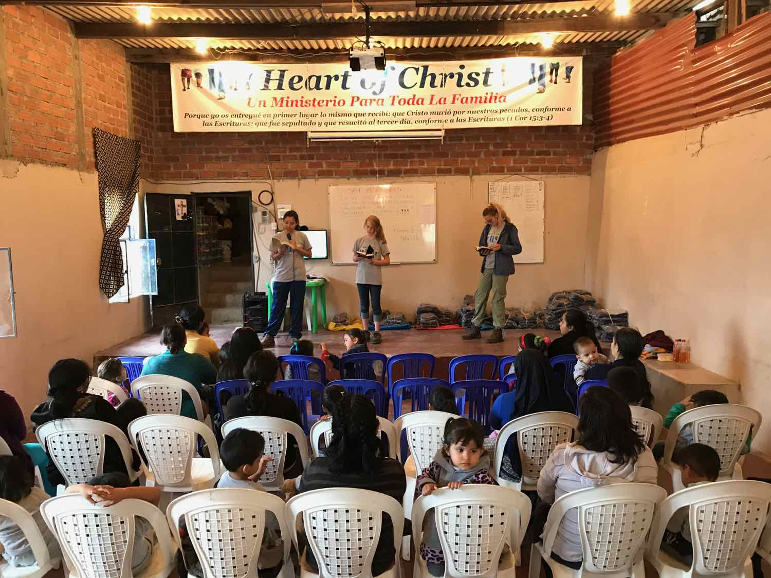Bethany shares the Gospel with small children and their mothers.