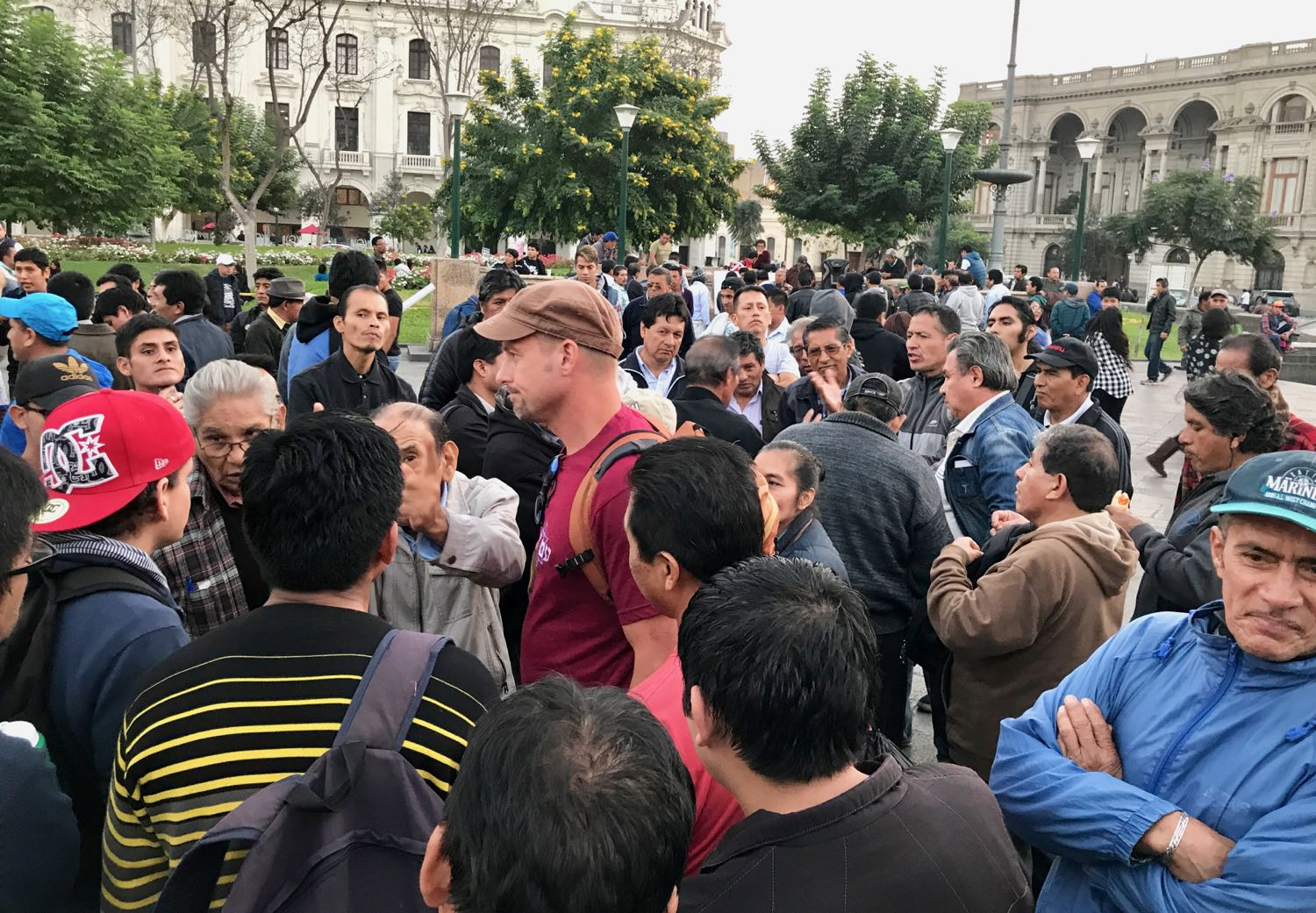 An old man shakes his finger at the Gospel in Plaza San Martin.