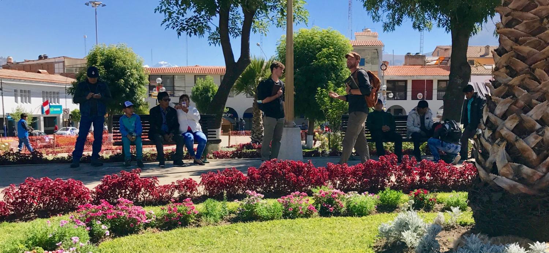 Jay preaches in Plaza de Armas in Huaraz; Jesse translates his exhortation into Spanish.