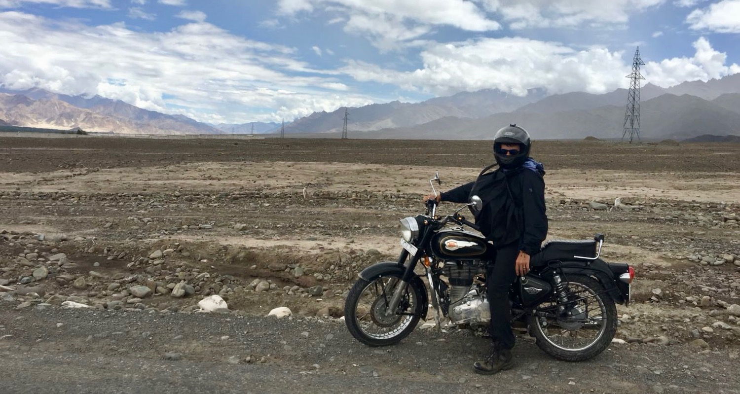 Eric pushes forward on a Royal Enfield, combing the Indus River Valley for the lost sheep.