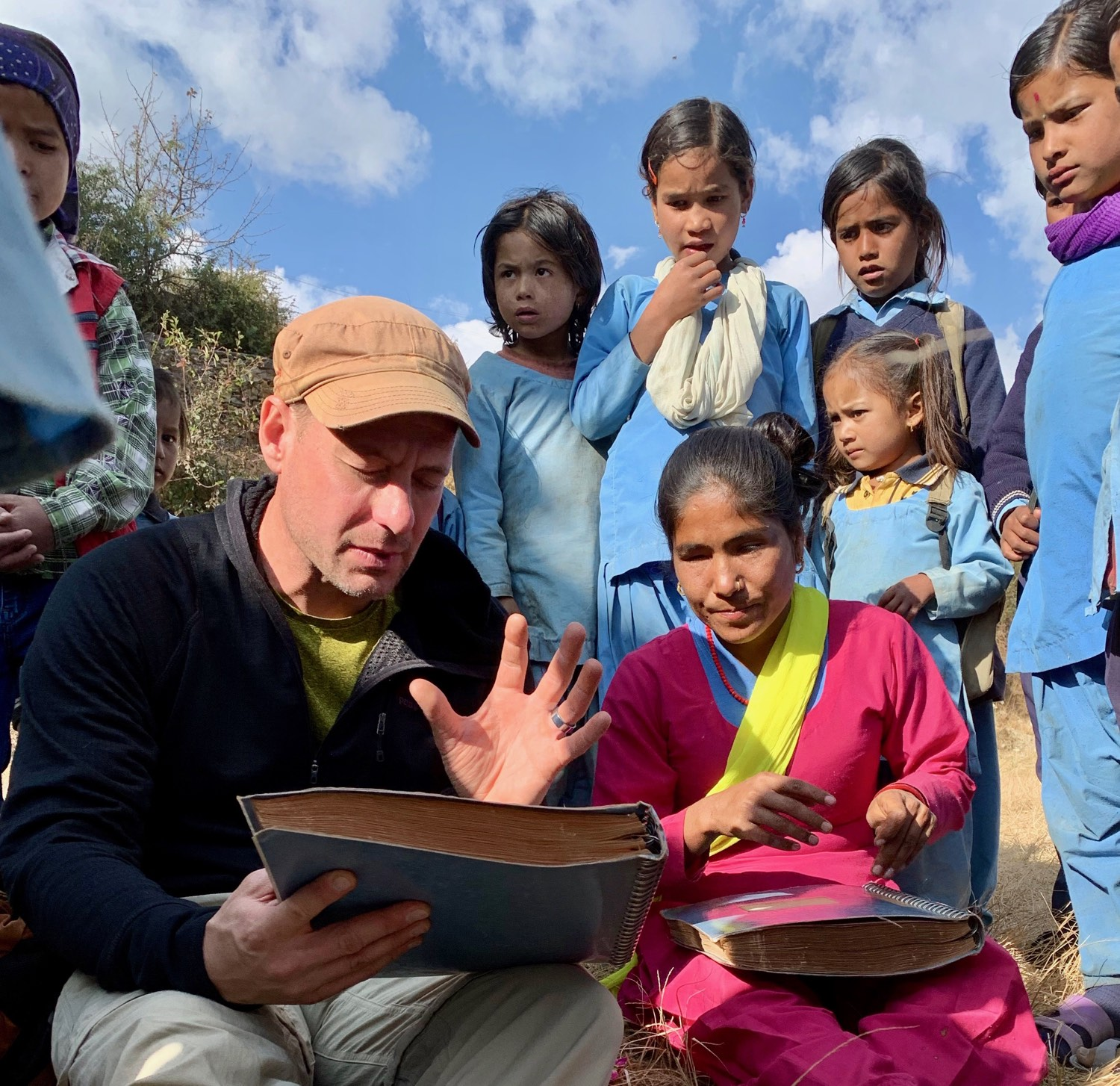 Explaining to a blind woman in Western Nepal that my Guru once opened the eyes of the blind.