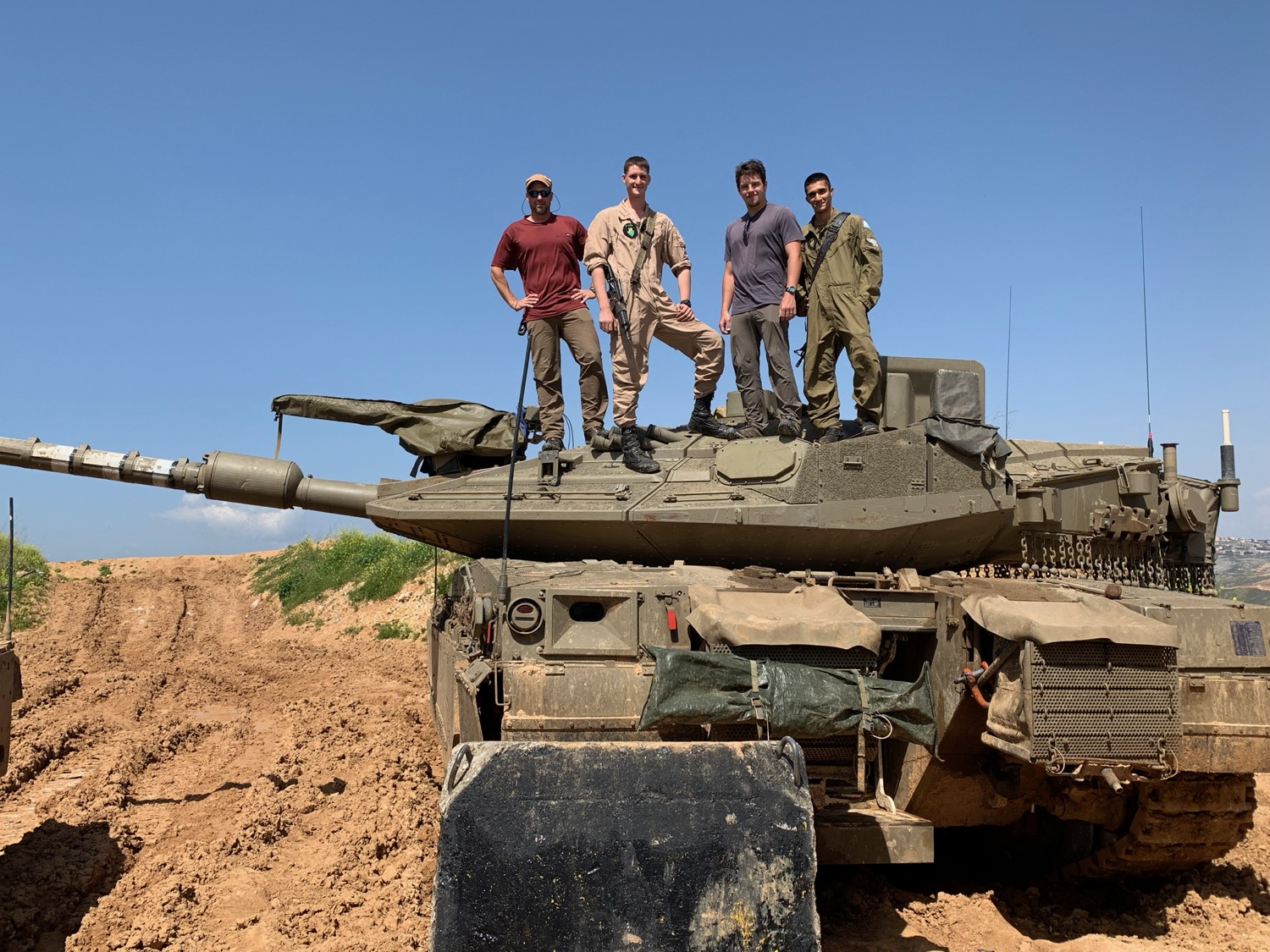 Witnessing as Watchmen in and atop Israeli tanks.