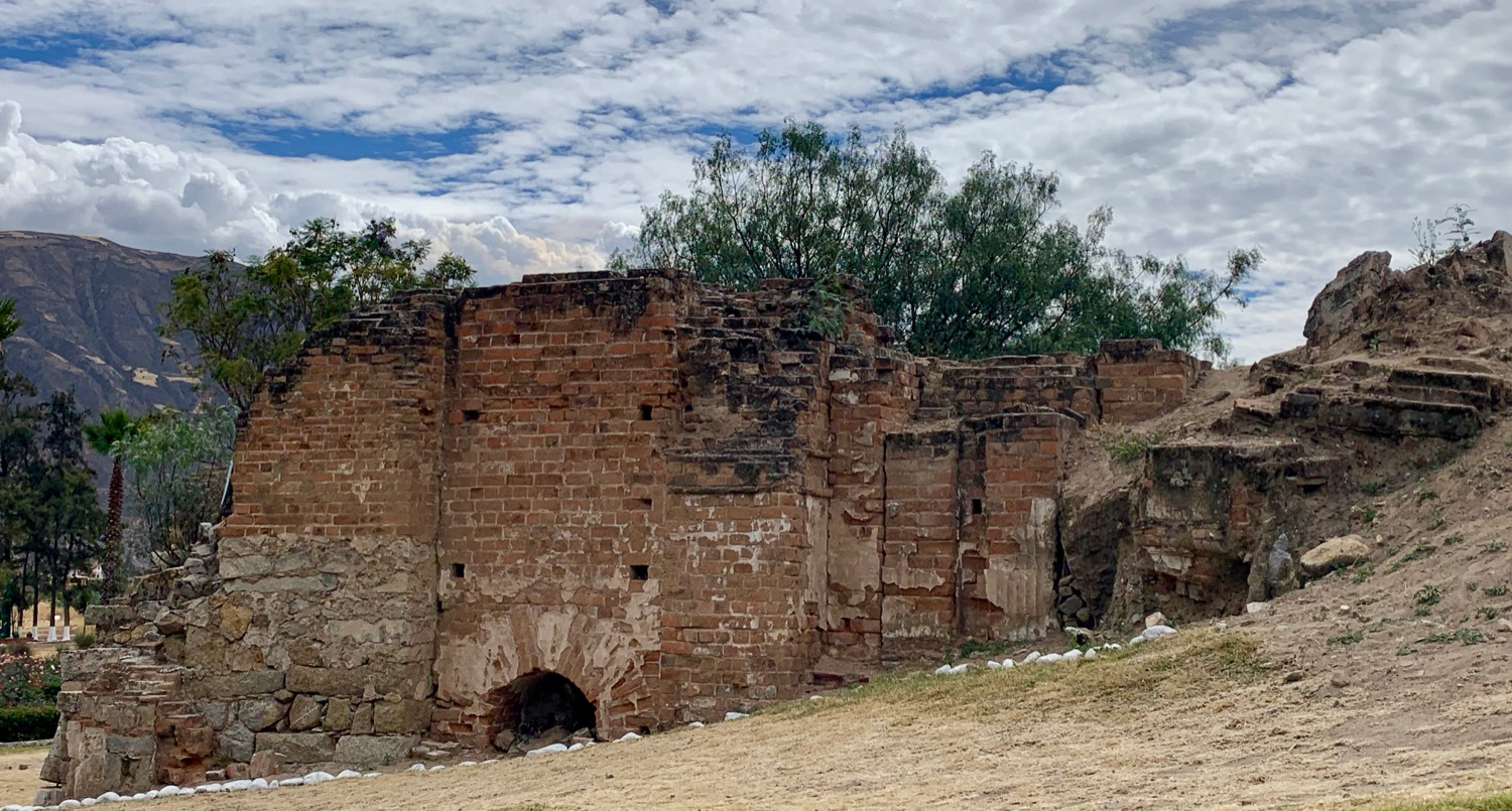 The remains of the top of original town cathedral in Yungay still poke out of the ground.