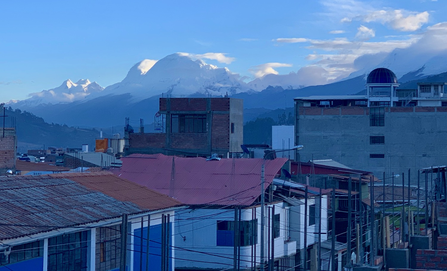 I see Huascarán every morning over coffee (center above brick tower). It looks much the same today as it did before a giant slab fell off and buried the town of Yungay.