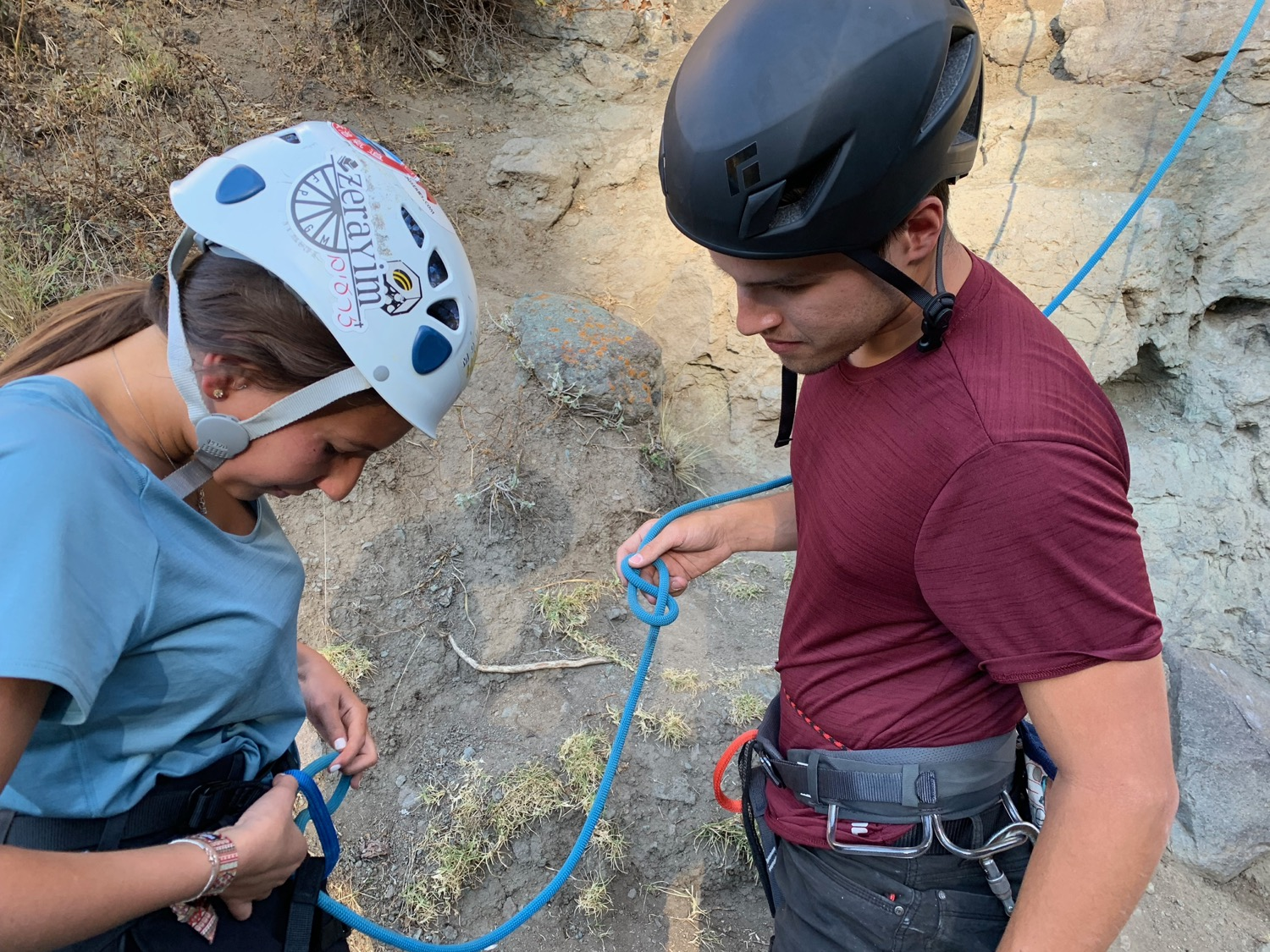 Eric teaches a young lady from Israel how to tie a figure-8 knot and secure herself to her climbing harness. Rock climbing can be a great tool for sharing the Gospel with Israeli backpackers who love adventure.
