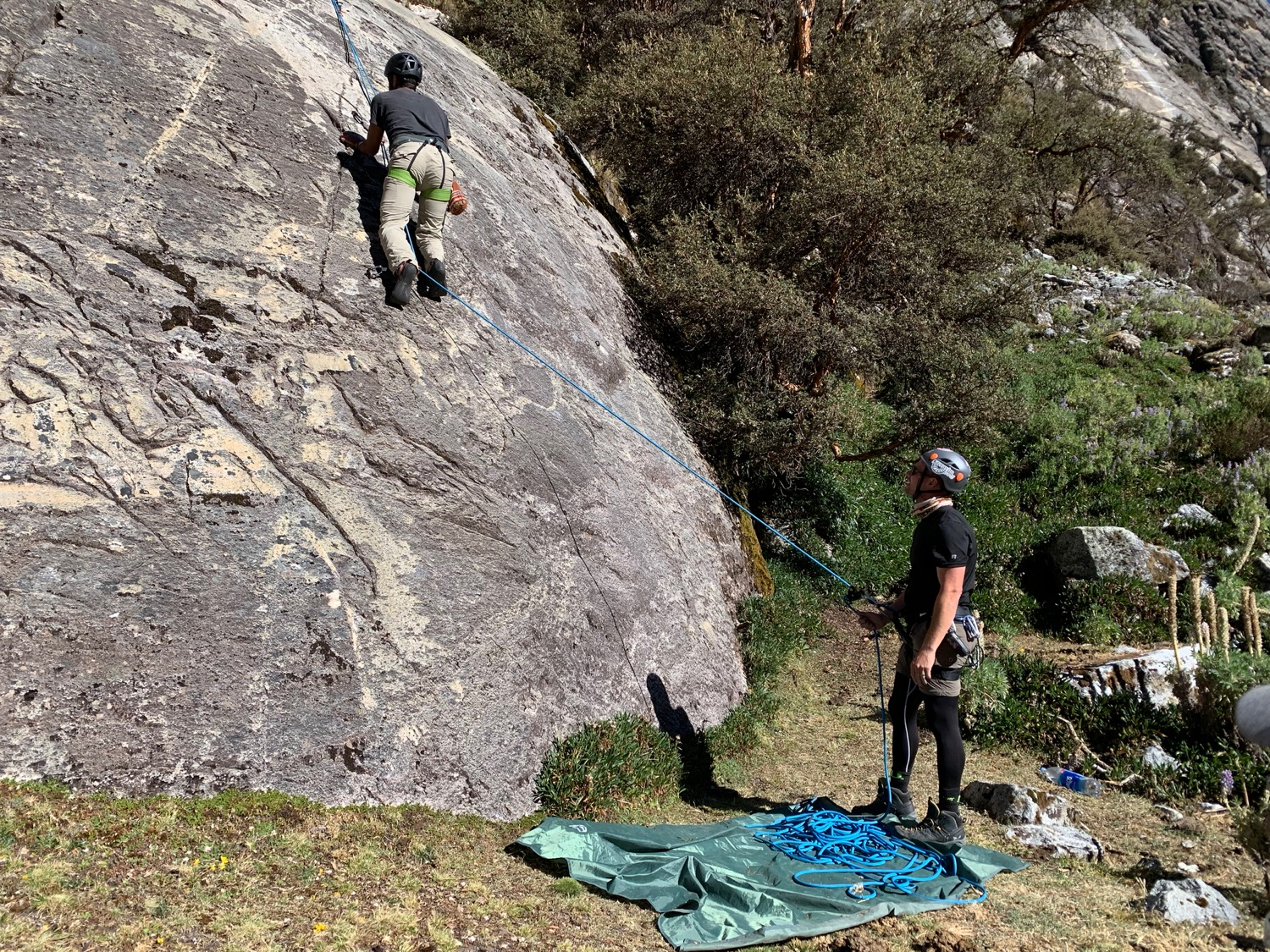 Jesse belays a former IDF soldier on a hard route at 14,700ft. up in the Llaca Valley.