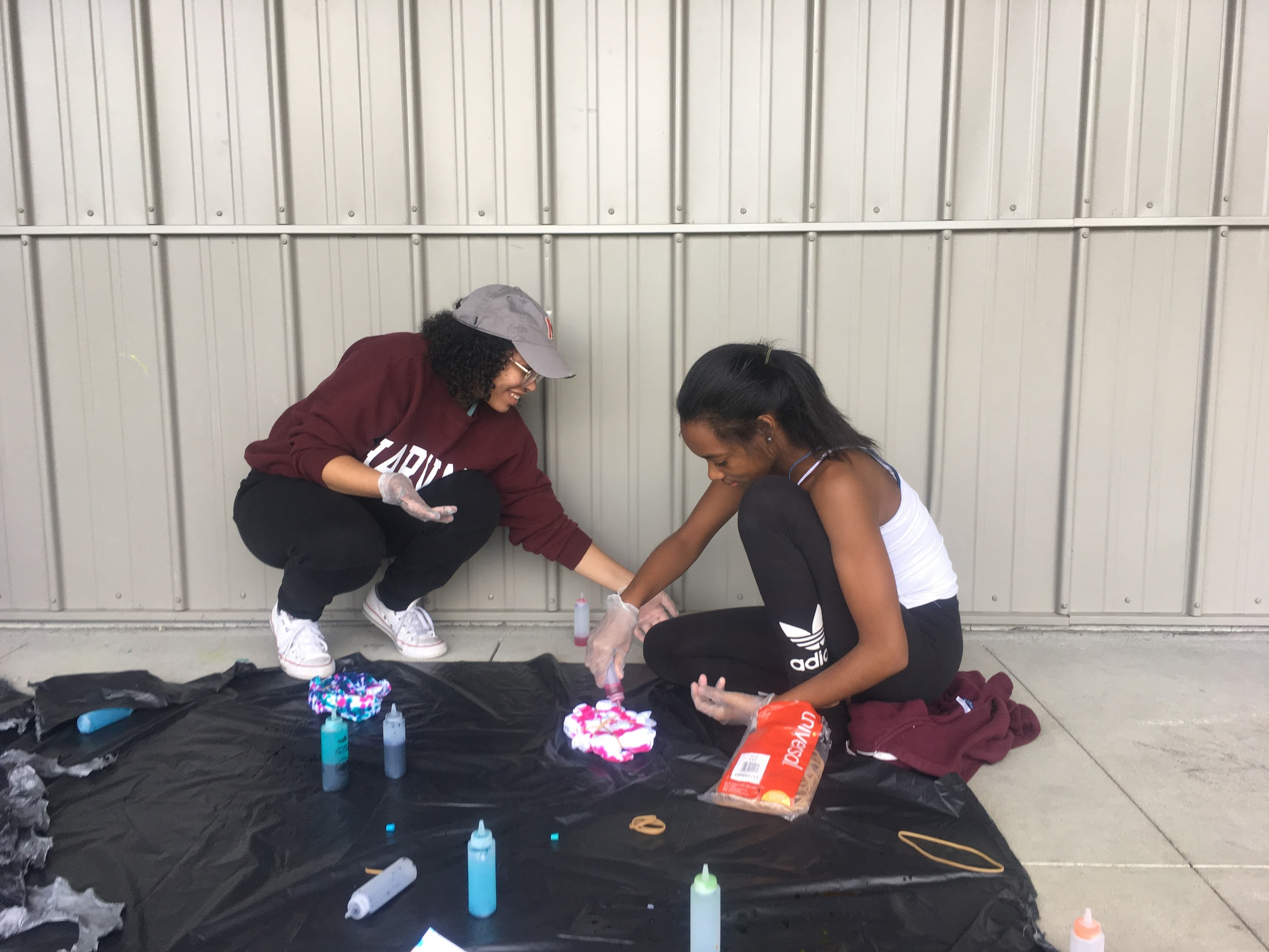 Ms. Rodrigues and Juju making their tie-dye t-shirts