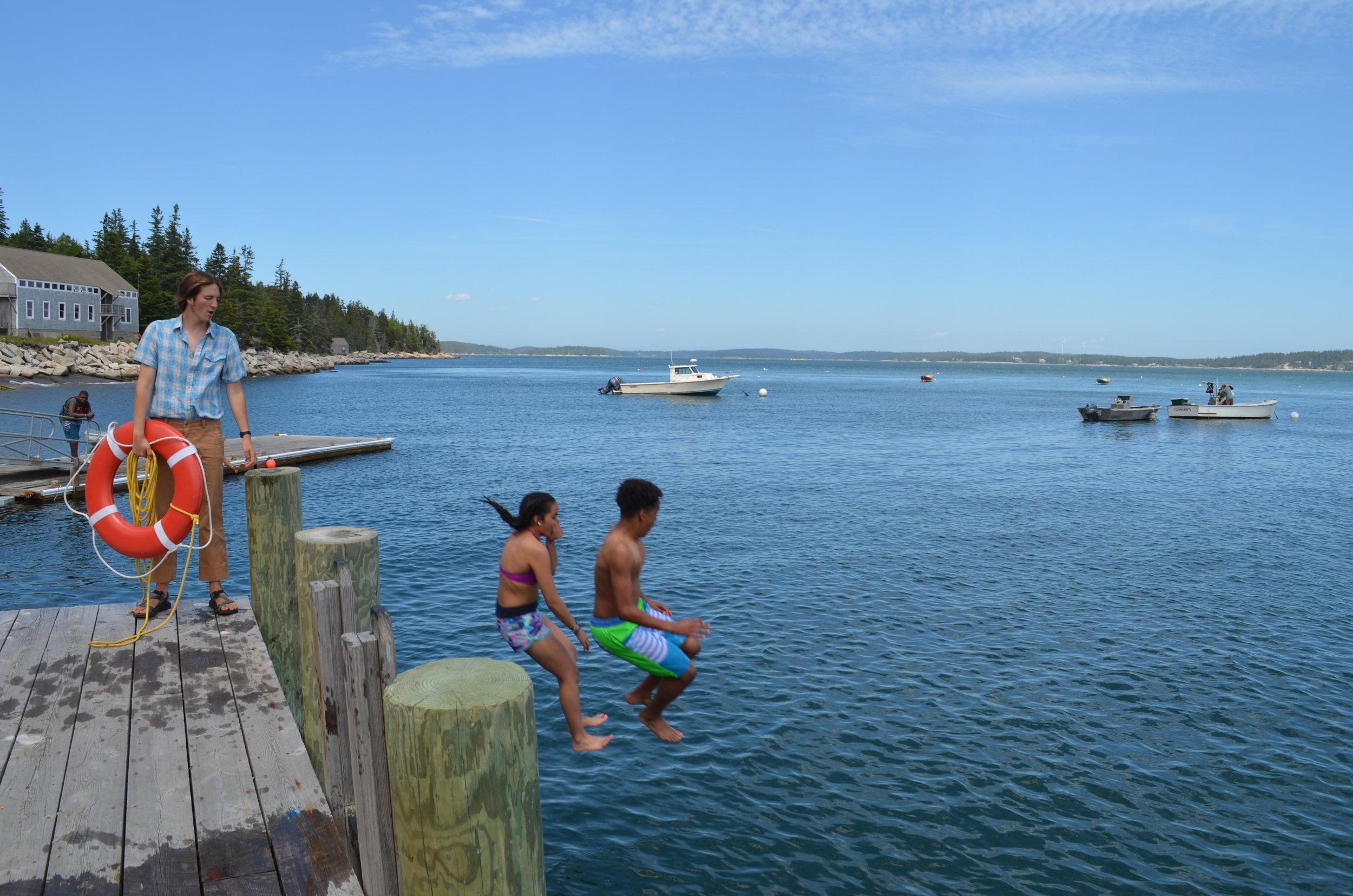 Anayah and Dario jumping into the cold water!