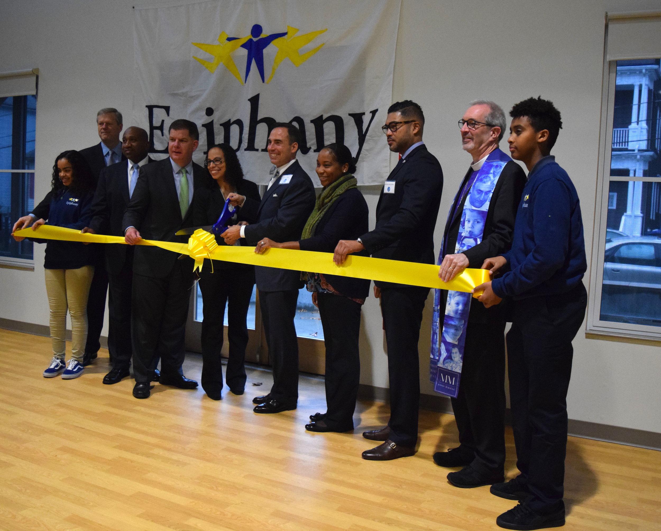 [left to right: Anayah (Epiphany 8th Grader), Governor Baker, Representative Holmes, Mayor Walsh, Dr. Sanchez, Rev. Finley, Councilor Campbell, Mr. Paris Jeffries, Bishop Gates and Romel(Epiphany 8th Grader)]