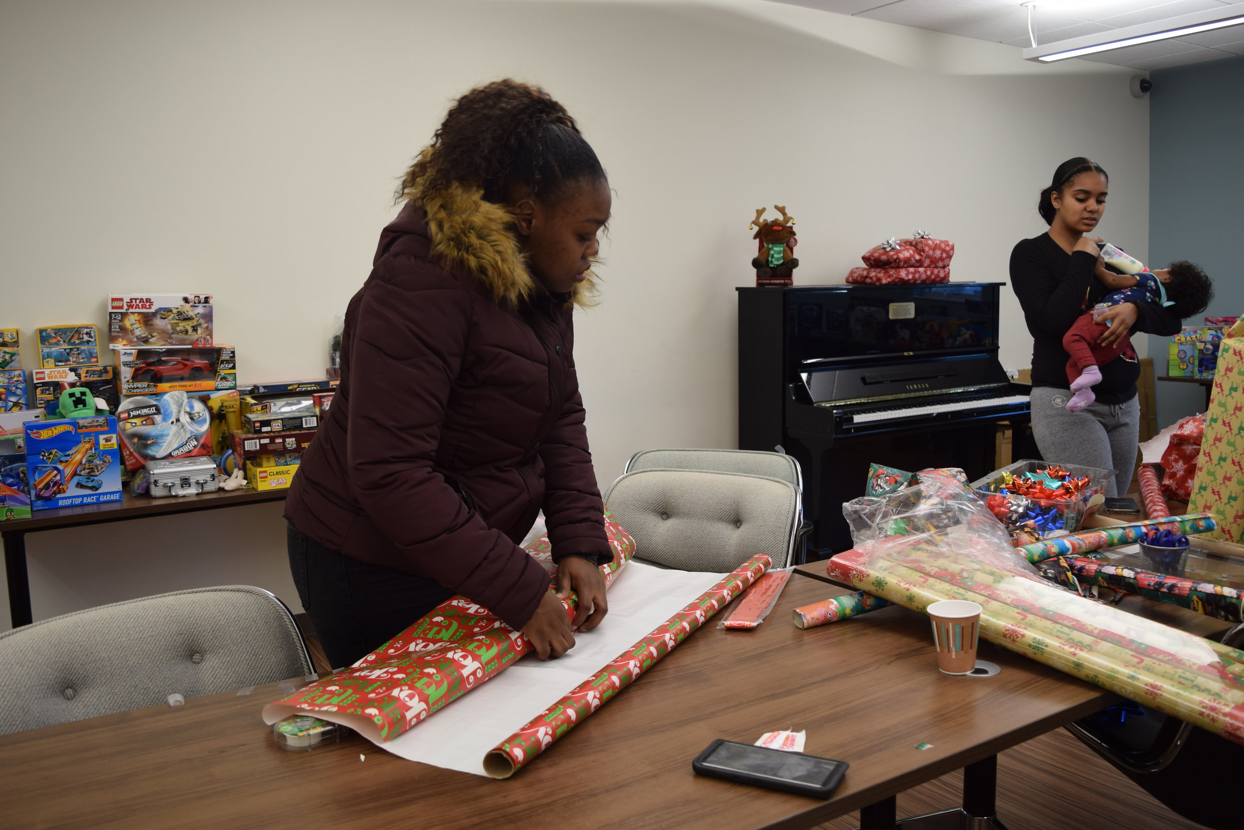 Teaka wrapping gifts for her family