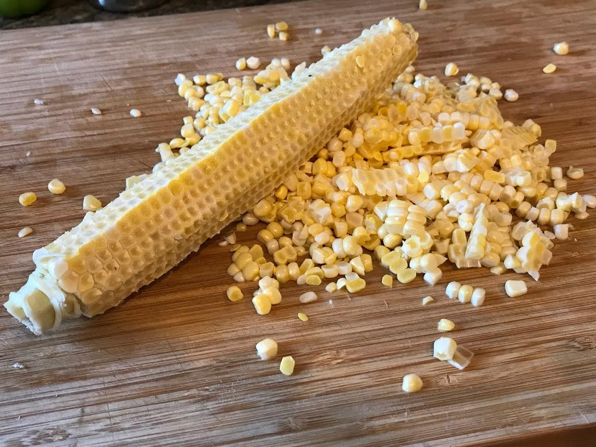 Corn kernels sliced off of corn cob.