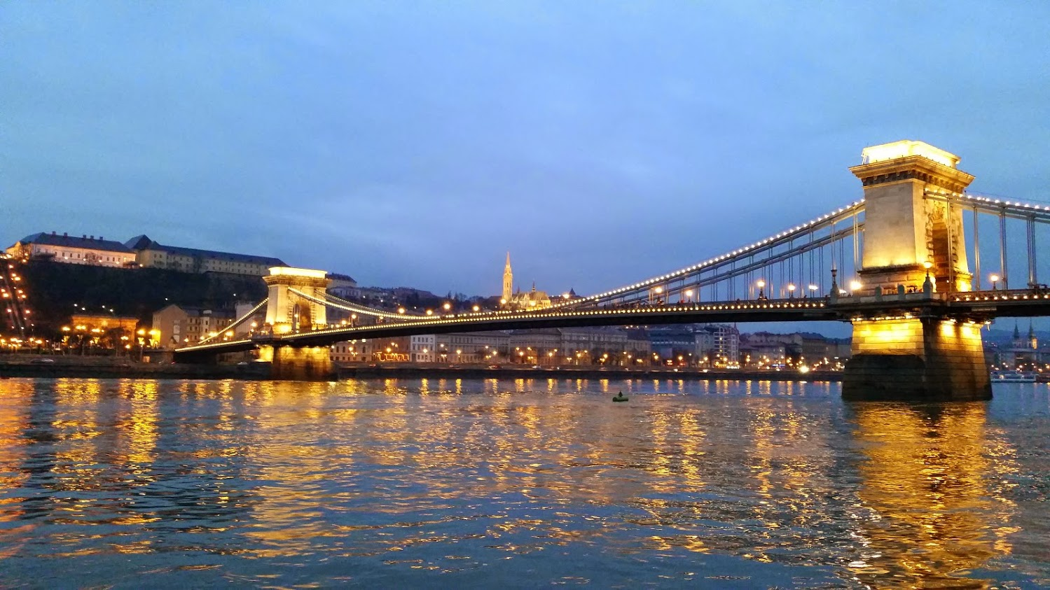 The bridge from Buda to Pest taken from our cruise ship window at sunset.