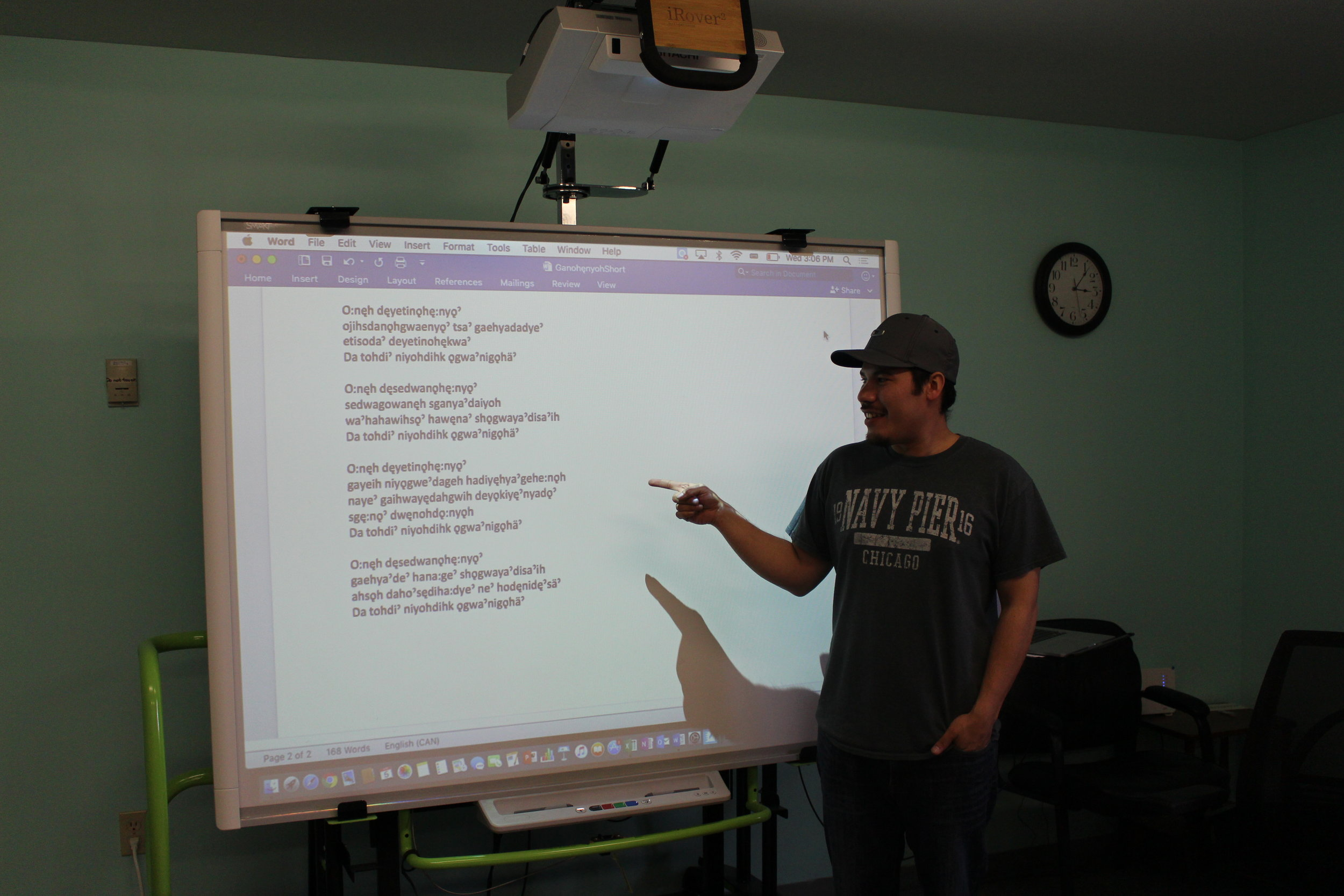 Instructor and Program Manager Ely Longboat teaches a lesson using a SMART board.