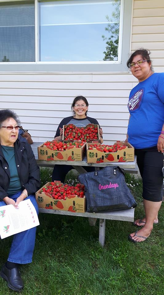 Our students go berry picking with one of our elders.