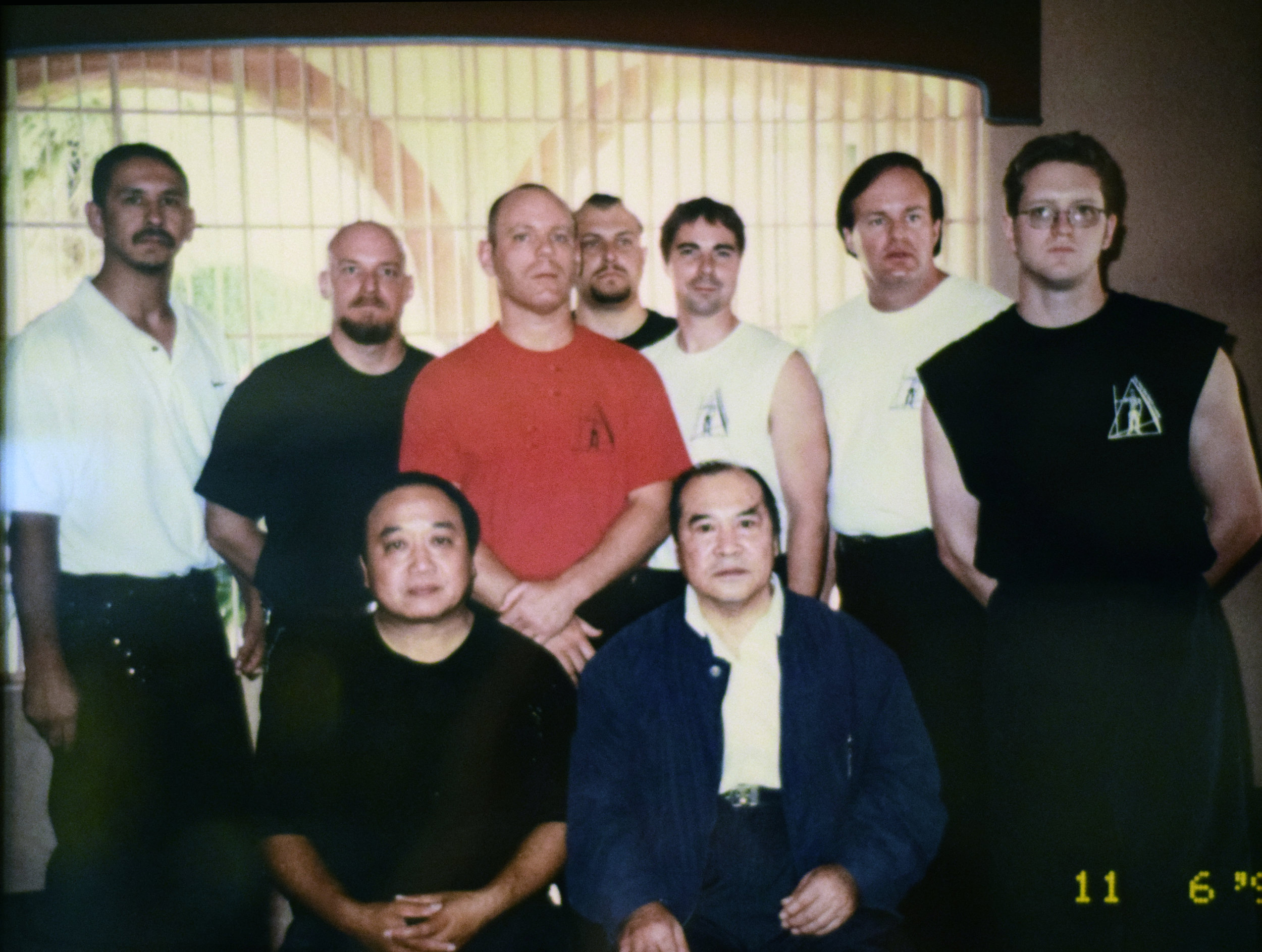 Professor Tufts  (red shirt) with  Sifu Augustine Fong  (front row on the left) and  Grandmaster Ho Kam Ming  (front row on the right)