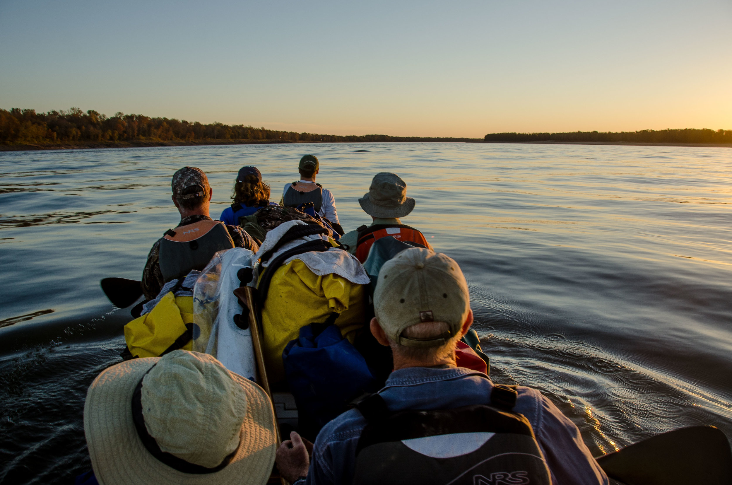 Paddling at dusk, from the author's first experience in a big canoe and on the Mississippi River in 2013. Photo Credit: John Ruskey.