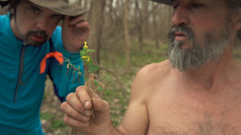 John Ruskey explores fauna on a nature walk, with paddler John Abnet onlooking. Photo Credit: Chris Battaglia.