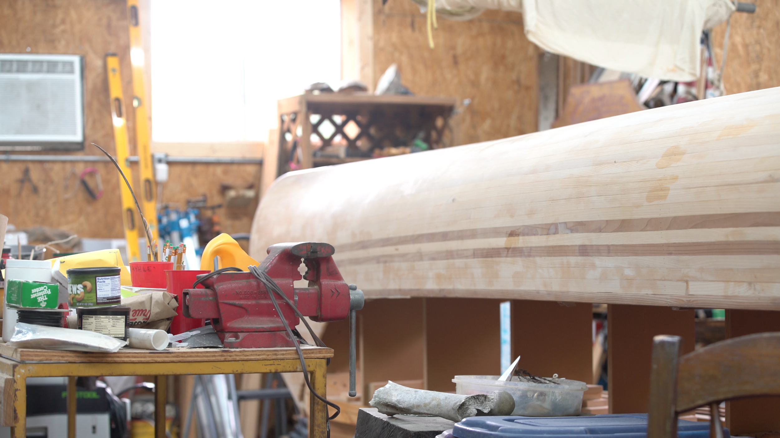 An unfinished voyageur canoe in the shop at Quapaw Canoe Company. Built in the style of Ted Moores strip construction , these boats are nearly 30 feet long, weigh nearly 400 pounds empty, and can carry up to 8 passengers fully loaded with personal and expedition gear (in the author's experience). Photo Credit: Chris Battaglia.