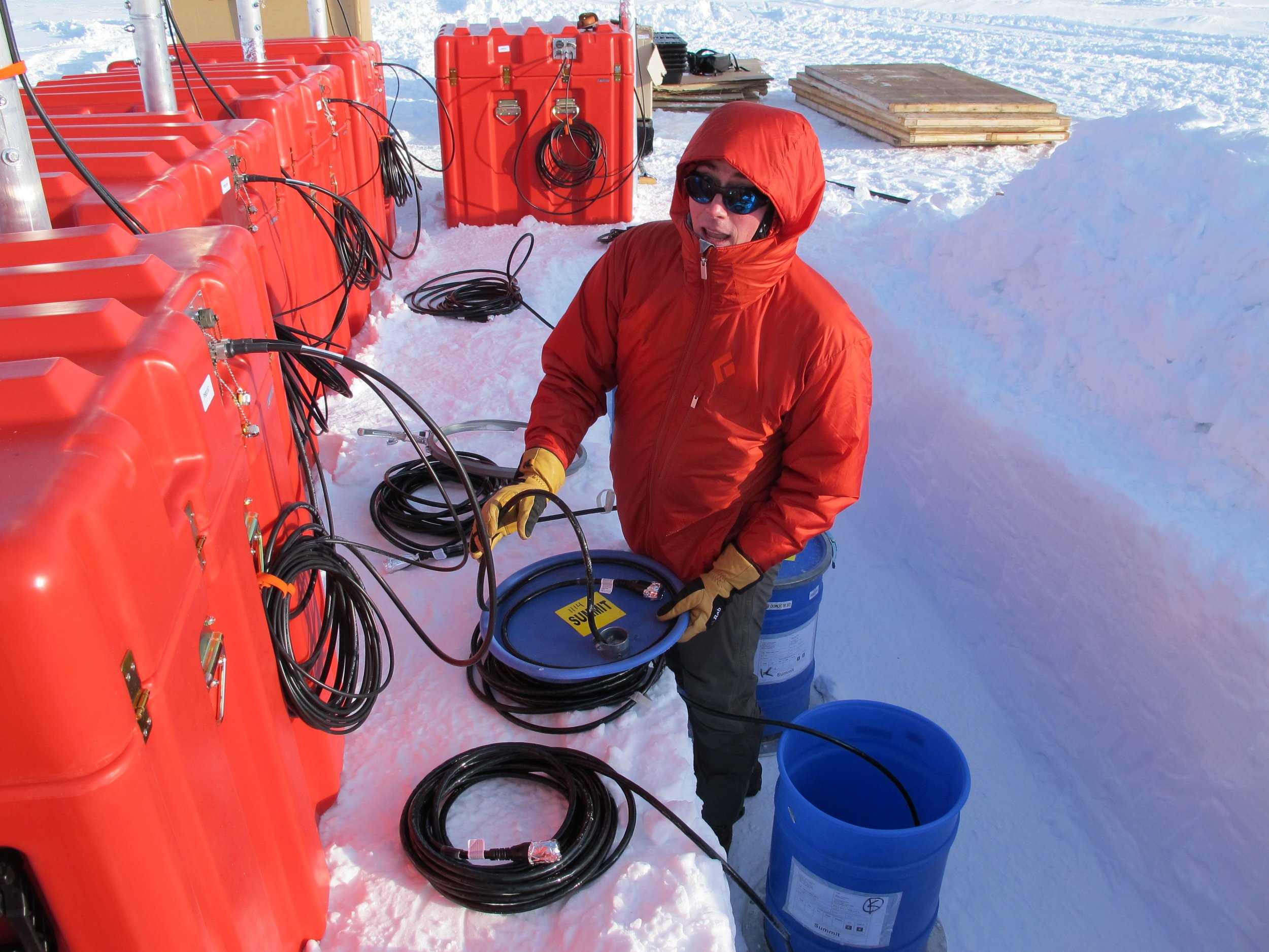 "It's me, in a hole, with a seismometer: ""Huddle"" testing at Summit Camp, Greenland."